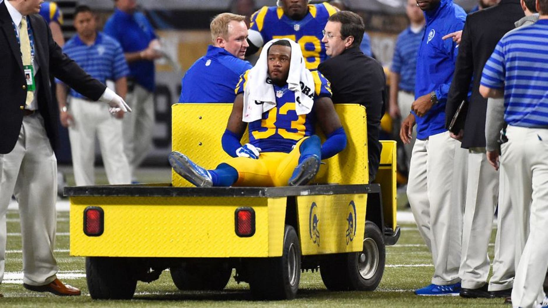 Dec 21, 2014; St. Louis, MO, USA; St. Louis Rams cornerback E.J. Gaines (33) is carted off the field after being injured against the New York Giants during the second half at the Edward Jones Dome. The New York Giants defeat the St. Louis Rams 37-27. Mandatory Credit: Jasen Vinlove-USA TODAY Sports