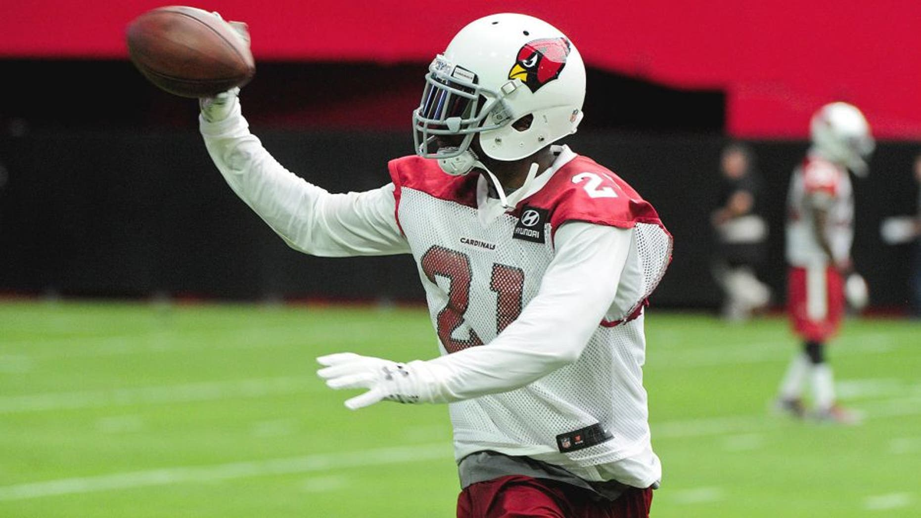 Aug 1, 2015; Glendale, AZ, USA; Arizona Cardinals cornerback Patrick Peterson (21) makes a one handed catch during training camp at University of Phoenix. Mandatory Credit: Matt Kartozian-USA TODAY Sports
