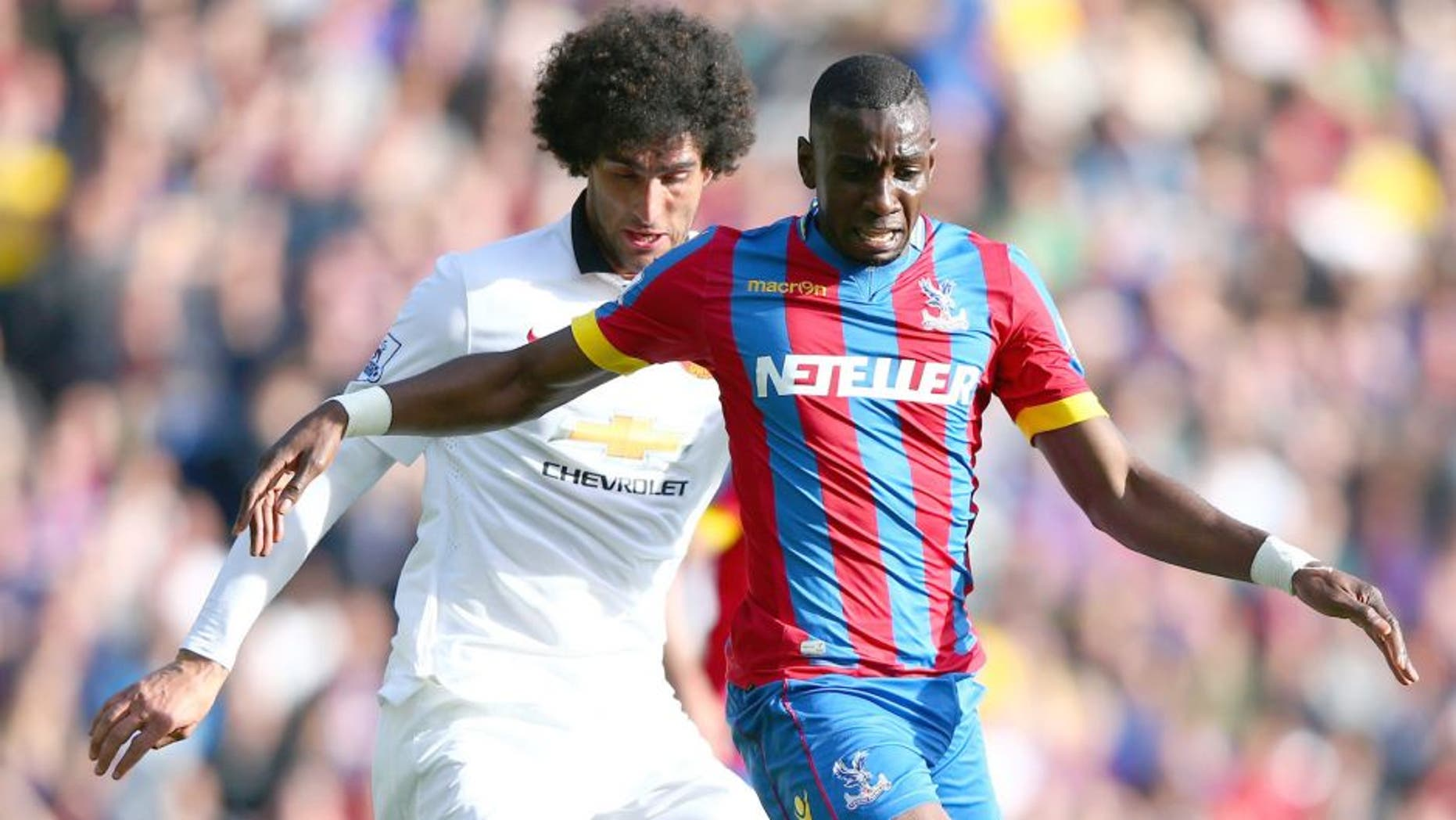 LONDON, ENGLAND - MAY 09: Yannick Bolasie of Crystal Palace is tackled by Marouane Fellaini of Manchester United during the Barclays Premier League match between Crystal Palace and Manchester United at Selhurst Park on May 9, 2015 in London, England. (Photo by Ian Walton/Getty Images)