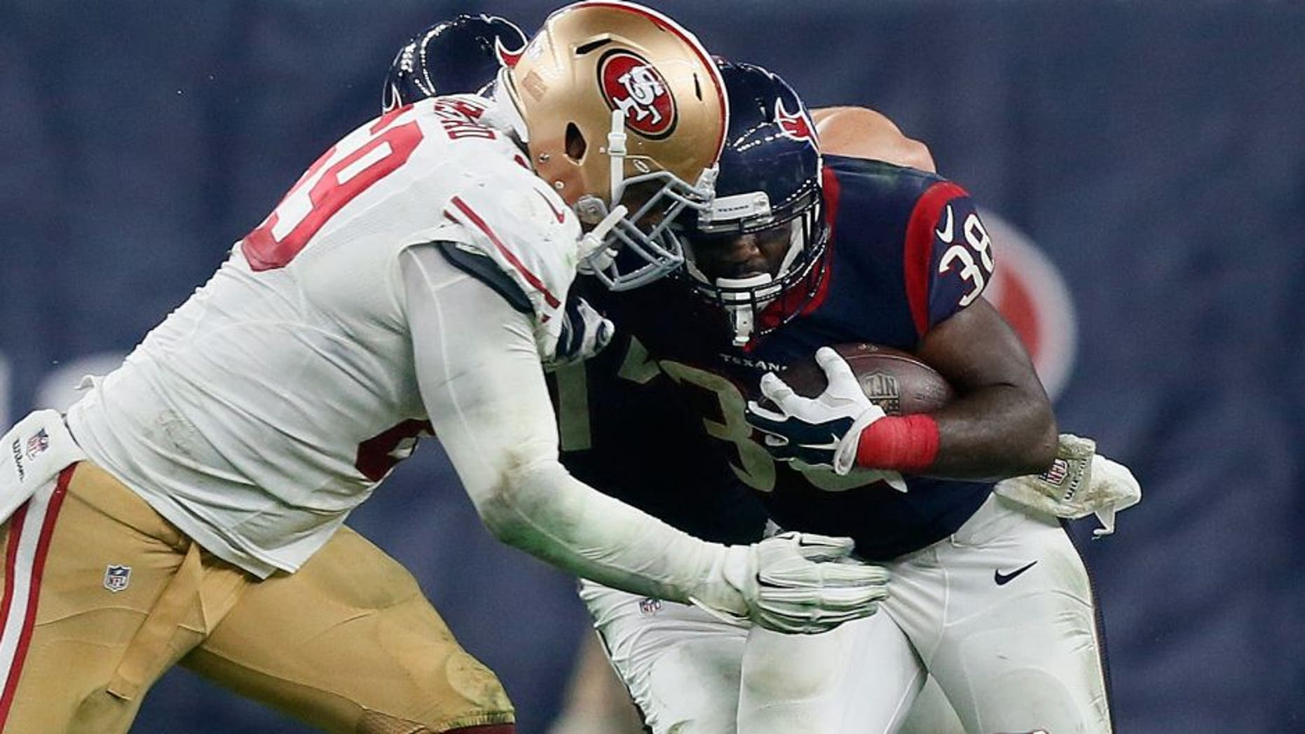 HOUSTON, TX - AUGUST 15: Kenny Hilliard #38 of the Houston Texans is tackled by Arik Armstead #69 of the San Francisco 49ers at Reliant Arena at Reliant Park on August 15, 2015 in Houston, Texas. (Photo by Bob Levey/Getty Images)