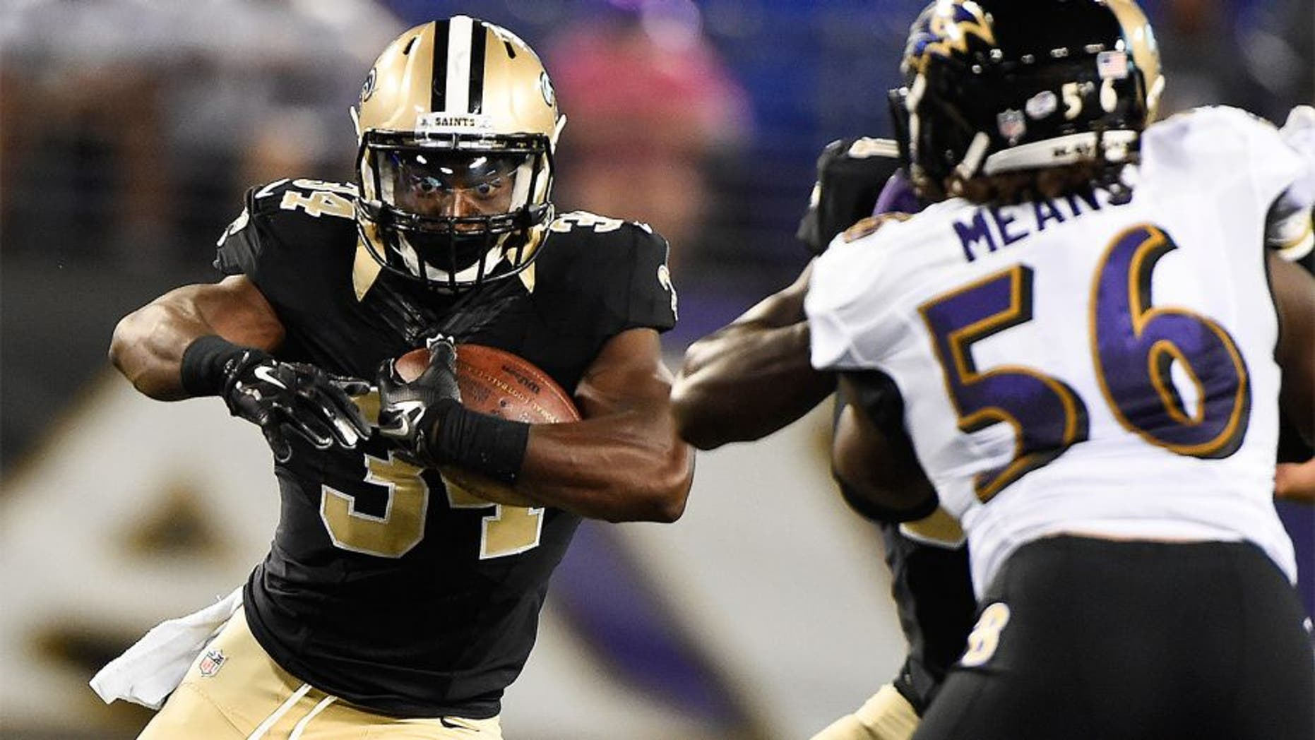 Aug 13, 2015; Baltimore, MD, USA; New Orleans Saints running back Tim Hightower (34) runs with the ball during the third quarter against the Baltimore Ravens in a preseason NFL football game at M&T Bank Stadium. Mandatory Credit: Tommy Gilligan-USA TODAY Sports