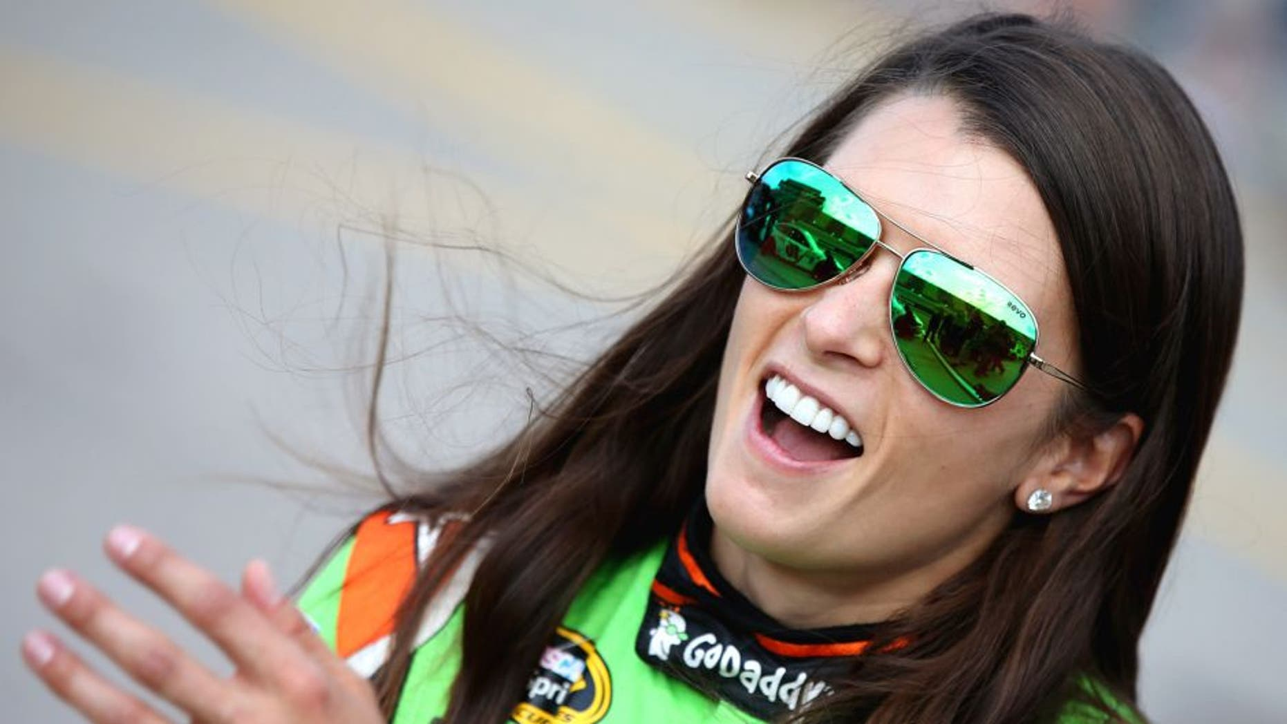 Danica Patrick, driver of the #10 GoDaddy Chevrolet, stands on the grid during qualifying for the NASCAR Sprint Cup Series Pure Michigan 400 at Michigan International Speedway on August 14, 2015 in Brooklyn, Michigan. (Photo by Sean Gardner/NASCAR via Getty Images)