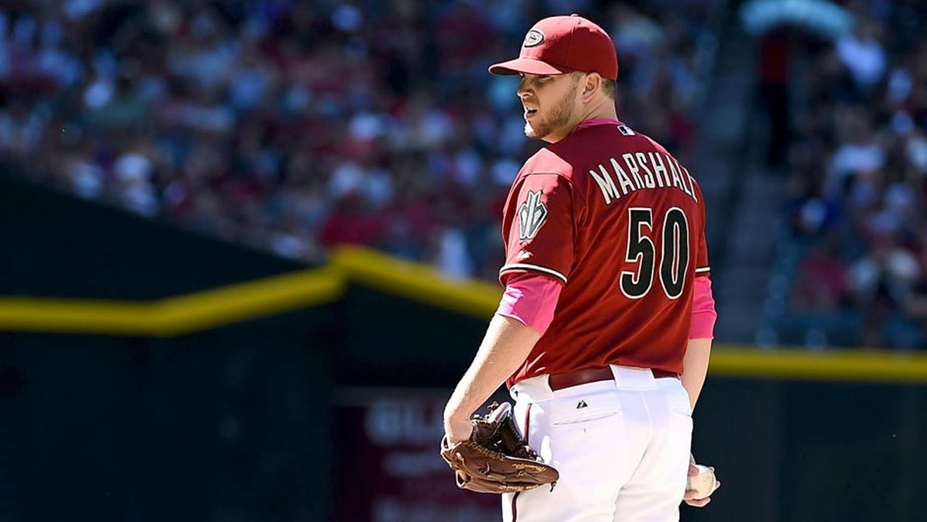 PHOENIX, AZ - MAY 10: Evan Marshall #50 of the Arizona Diamondbacks delivers a pitch against the San Diego Padres at Chase Field on May 10, 2015 in Phoenix, Arizona. (Photo by Norm Hall/Getty Images)