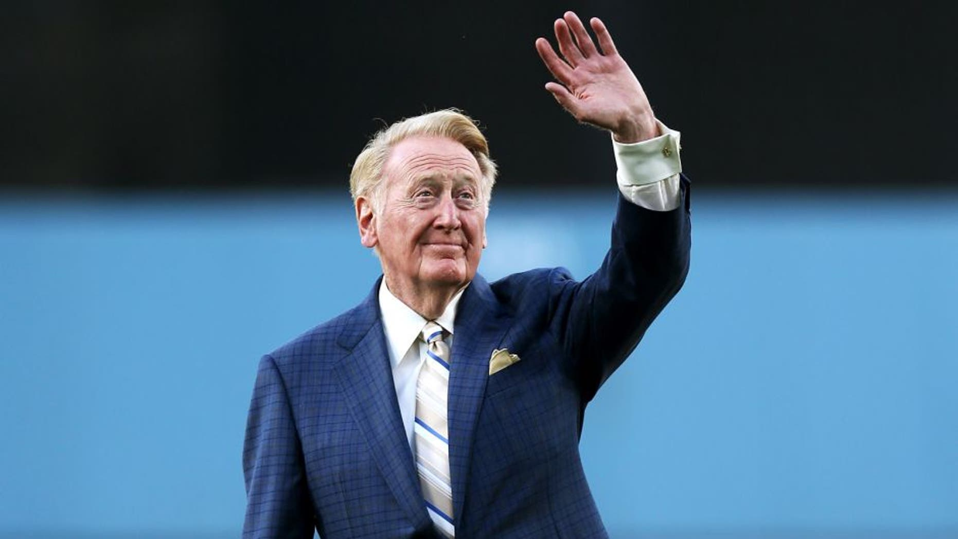 LOS ANGELES, CA - AUGUST 30: Dodger broadcaster Vin Scully waves to the crowd before throwing out the first pitch during ceeremoniew honoring him on his 64 years of sevice before the game between the Arizona Diamondbacks and the Los Angeles Dodgers on August 30, 2012 at Dodger Stadium in Los Angeles, California. (Photo by Stephen Dunn/Getty Images)
