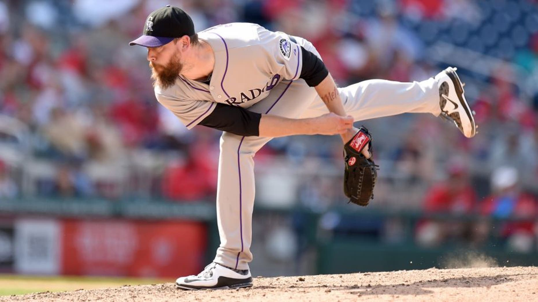 WASHINGTON, DC - AUGUST 09: John Axford #66 of the Colorado Rockies pitches in the eighth inning and get credit for the win during a baseball game against the Washington Nationals at Nationals Park on August 9, 2015 in Washington, DC. The Rockies won 6-4. (Photo by Mitchell Layton/Getty Images)