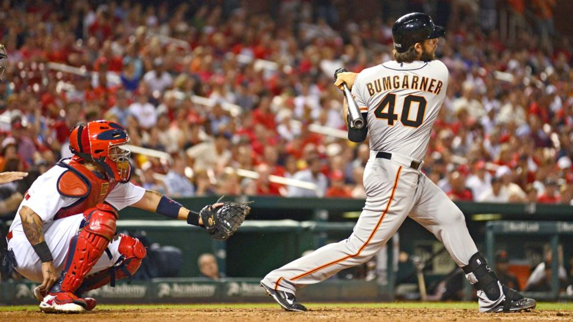Aug 18, 2015; St. Louis, MO, USA; San Francisco Giants pinch hitter Madison Bumgarner (40) hit s a single off of St. Louis Cardinals starting pitcher Lance Lynn (not pictured) during the seventh inning at Busch Stadium. Mandatory Credit: Jeff Curry-USA TODAY Sports