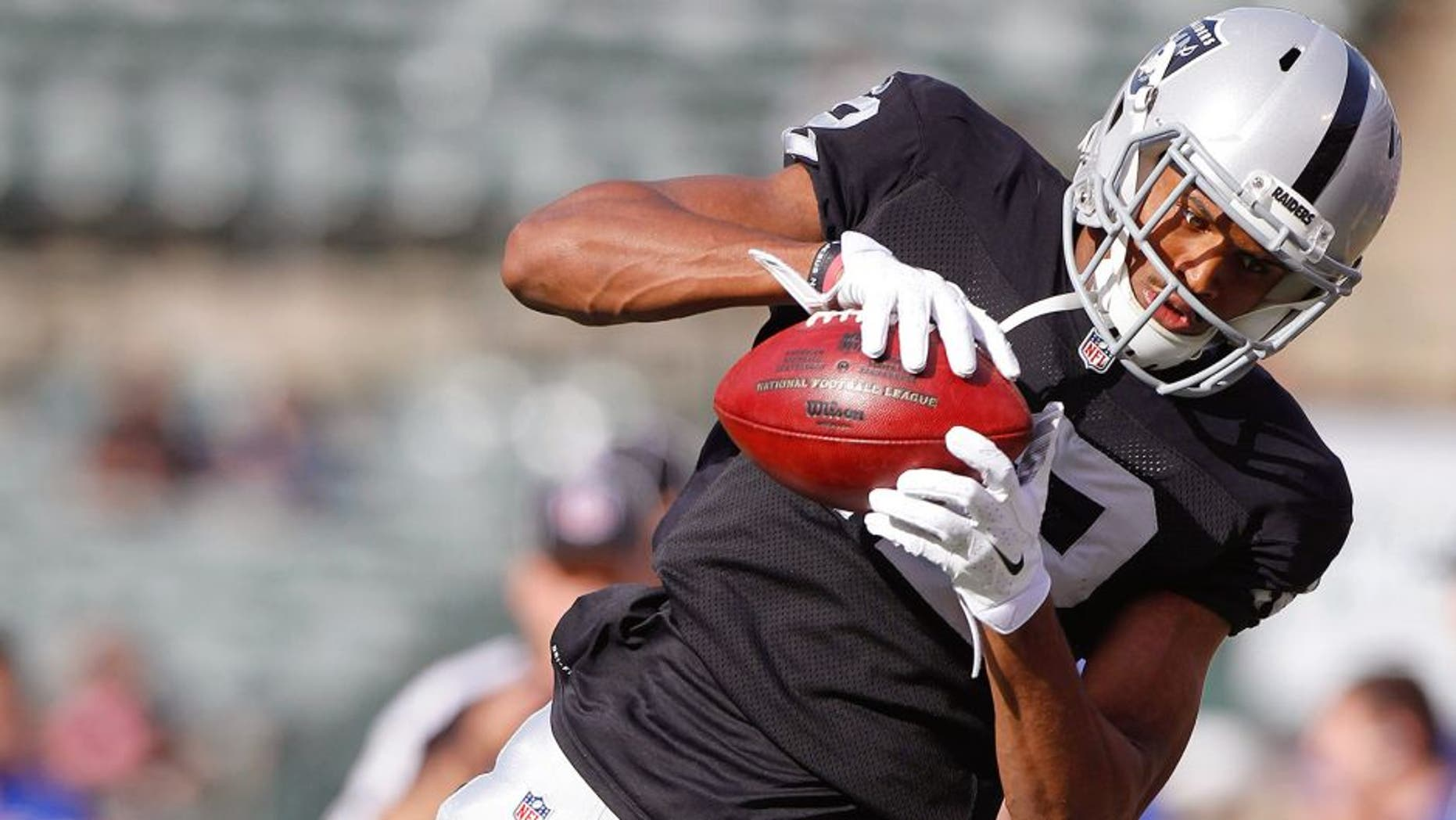 Dec 21, 2014; Oakland, CA, USA; Oakland Raiders wide receiver Brice Butler (12) catches a pass before a game against the Buffalo Bills at O.co Coliseum. Mandatory Credit: Cary Edmondson-USA TODAY Sports