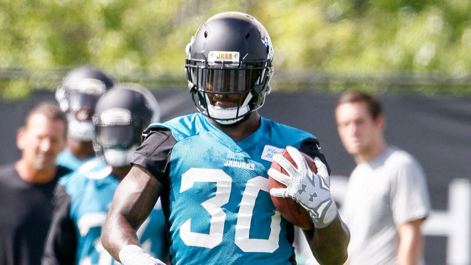 JACKSONVILLE, FL - MAY 27: Runningback Bernard Pierce #30 of the Jacksonville Jaguars during his team OTA's at Everbank Field Stadium at the Florida Blue Health and Wellness Practice Fields on May 27, 2015 in Jacksonville, Florida. (Photo by Don Juan Moore/Getty Images)