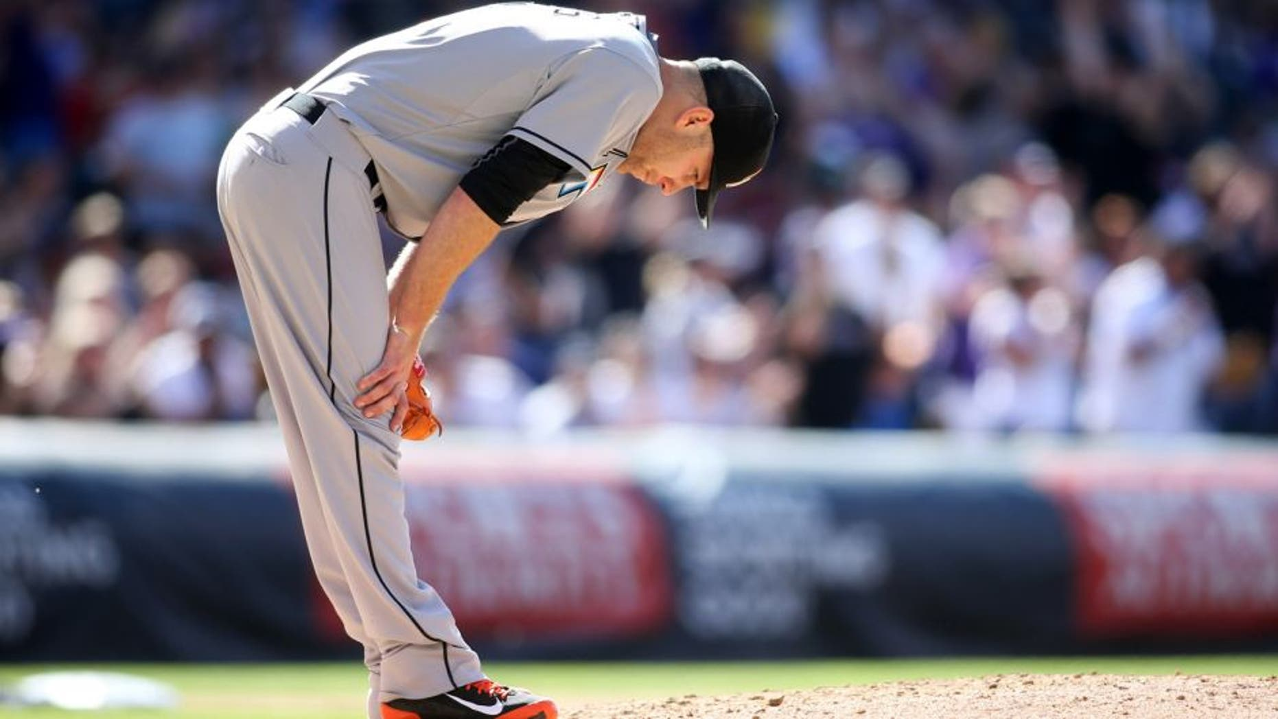 Jun 6, 2015; Denver, CO, USA; Miami Marlins starting pitcher David Phelps (41) reacts after Colorado Rockies right fielder Carlos Gonzalez (5) hit a home run during the fourth inning at Coors Field. Mandatory Credit: Chris Humphreys-USA TODAY Sports