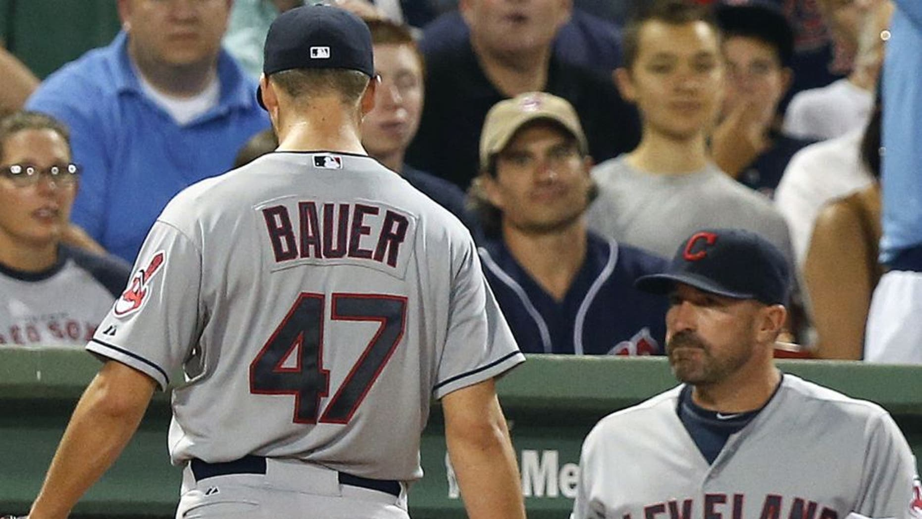 Trevor Bauer leaves the baseball game after being taken out during the second inning after giving up five runs vs. the Boston Red Sox