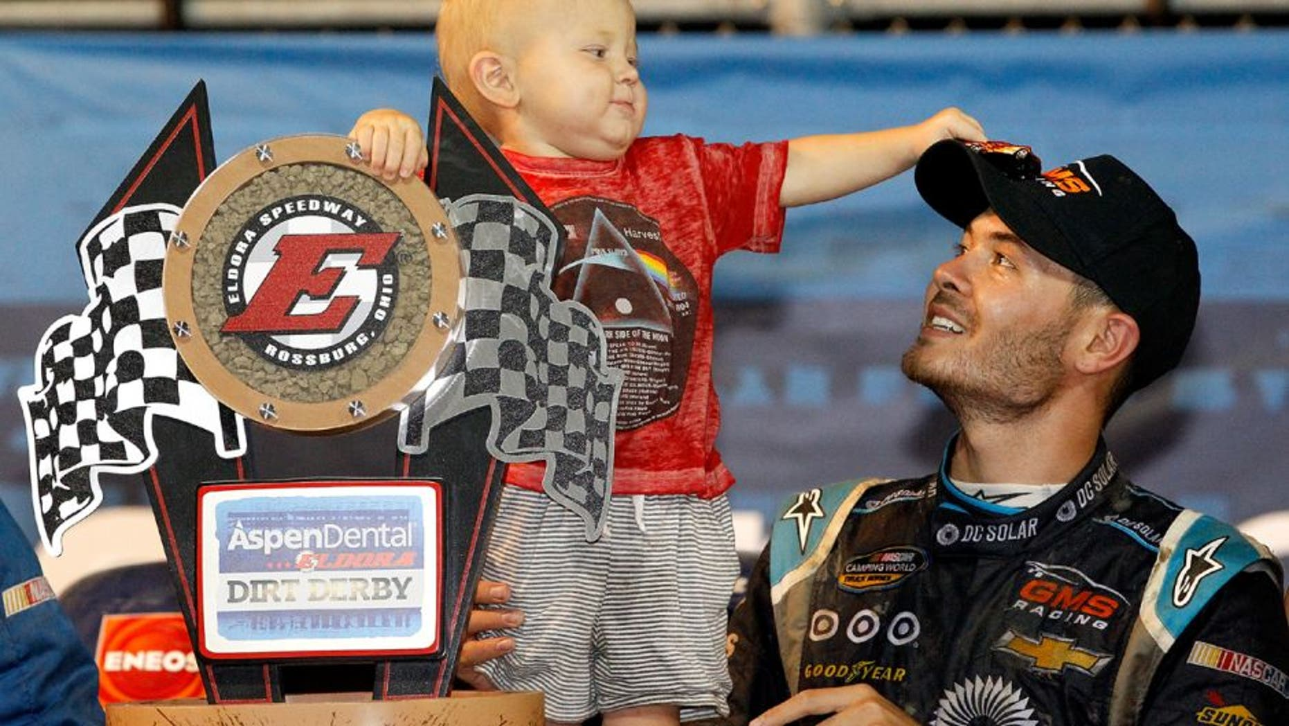 ROSSBURG, OH - JULY 20: Kyle Larson, driver of the #24 DC Solar Chevrolet, and his son Owen Larson hold the NASCAR Camping World Series 4th Annual Aspen Dental Eldora Dirt Derby 150 trophy after winning at Eldora Speedway on July 20, 2016 in Rossburg, Ohio. (Photo by Brian Lawdermilk/Getty Images)