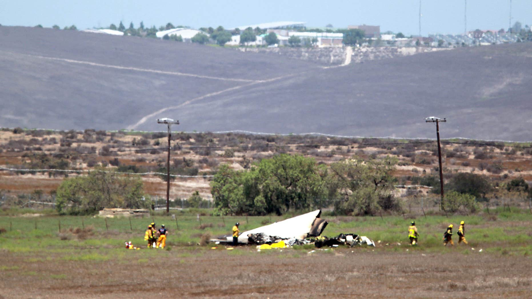 Aug. 16, 2015: Authorities say multiple people died following the midair collision and crash of two small planes near an airport in southern San Diego County.