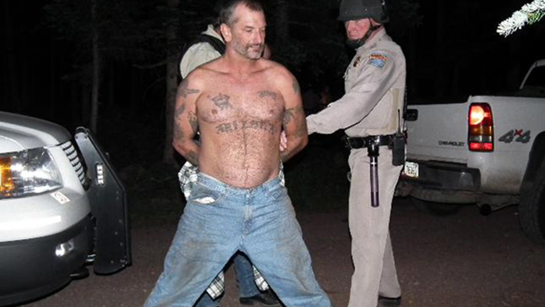 Aug. 19: In this photo provided by the U.S. Marshals Service, fugitive John McCluskey is shown being taken into custody by U.S. Marshals in eastern Arizona. McCluskey and his fiancee Casslyn Welch had been on the run since July 30.