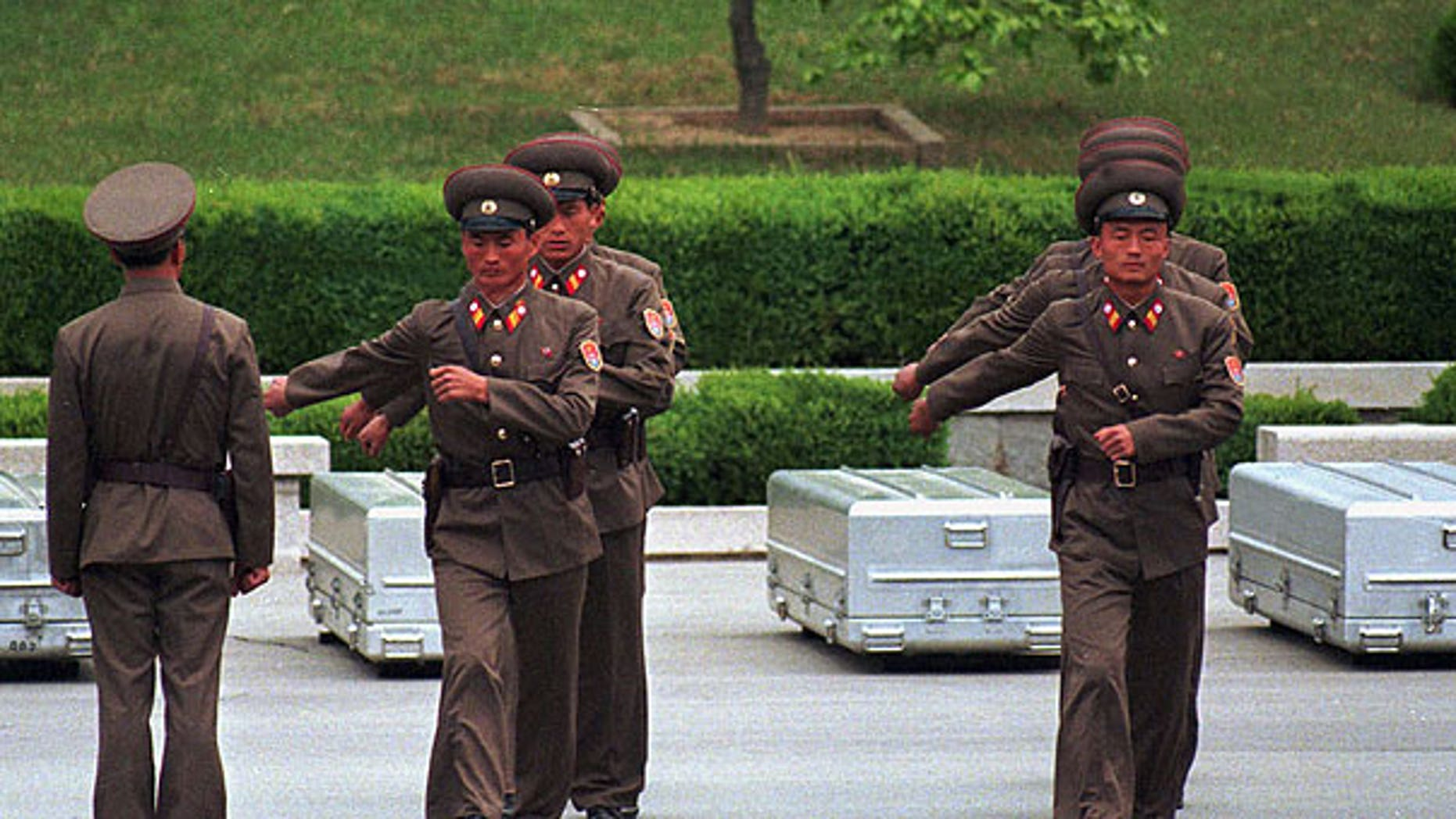 In this May 14, 1999 file photo, North Korean soldiers march away from coffins containing the remains of the American soldiers during a ceremony at the border village of Panmunjom, north of Seoul, South Korea. North Korea said Friday, Aug. 19, 2011, it has accepted a U.S. proposal to hold talks on finding the remains of American soldiers buried in the North.
