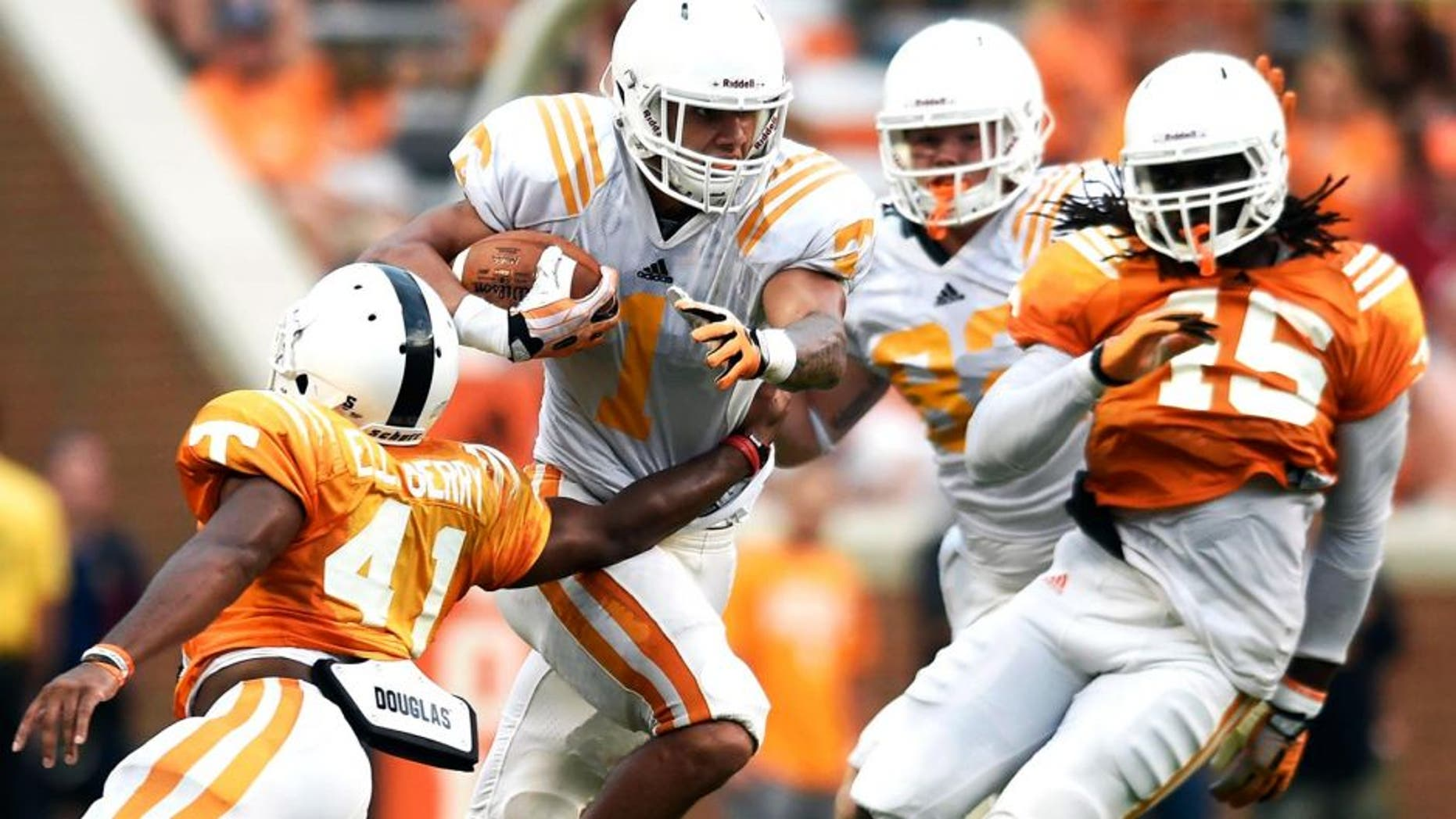 Tennessee running back Jalen Hurd (1) breaks a tackle by Tennessee defensive back Elliott Berry (41) during Tennessee's open practice at Neyland Stadium in Knoxville on Saturday, Aug. 16, 2014. (AP Photo/Knoxville News Sentinel, Adam Lau)