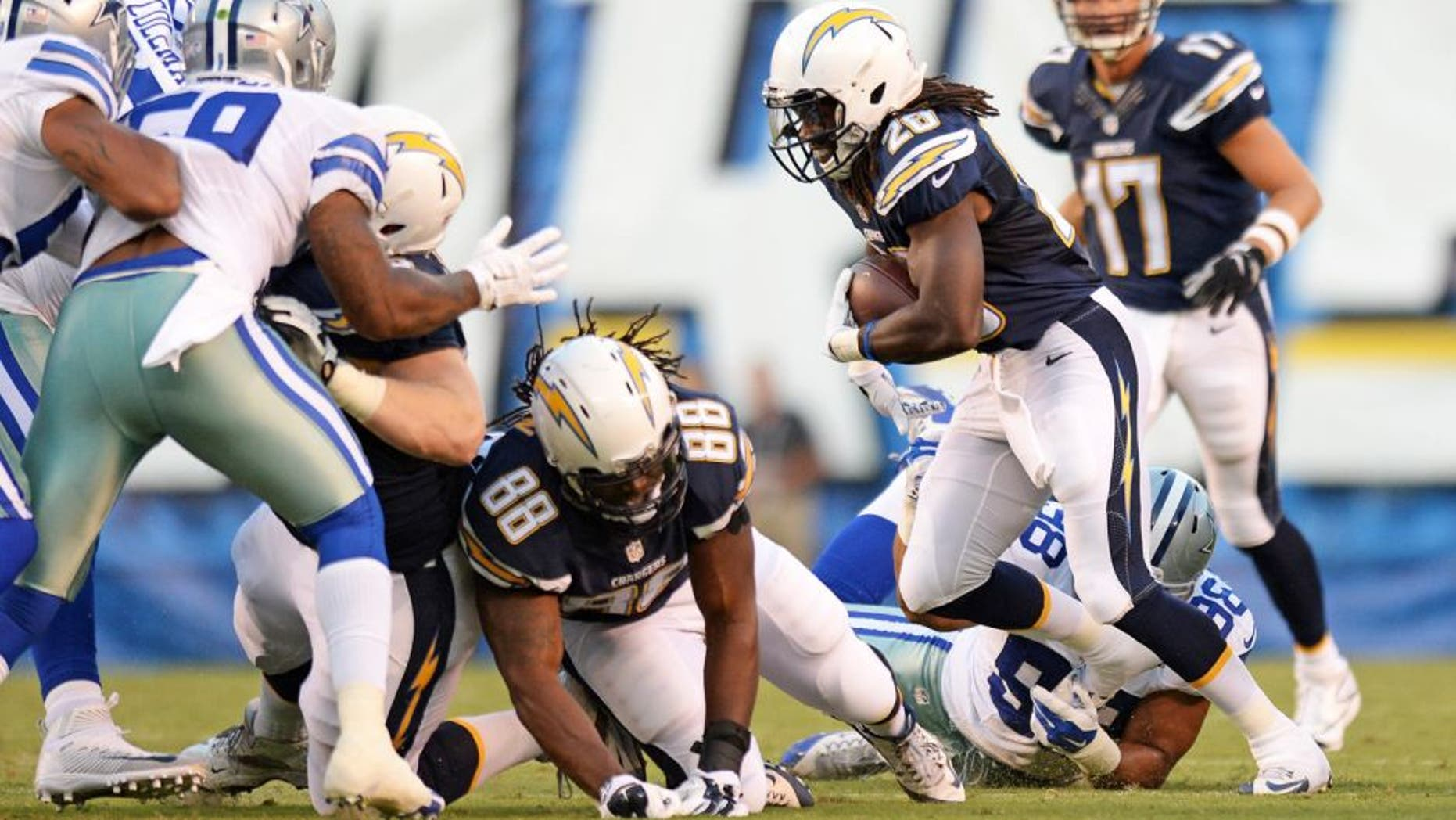 Aug 13, 2015; San Diego, CA, USA; San Diego Chargers running back Melvin Gordon (28) runs against the Dallas Cowboys during the first quarter in a preseason NFL football game at Qualcomm Stadium. Mandatory Credit: Jake Roth-USA TODAY Sports
