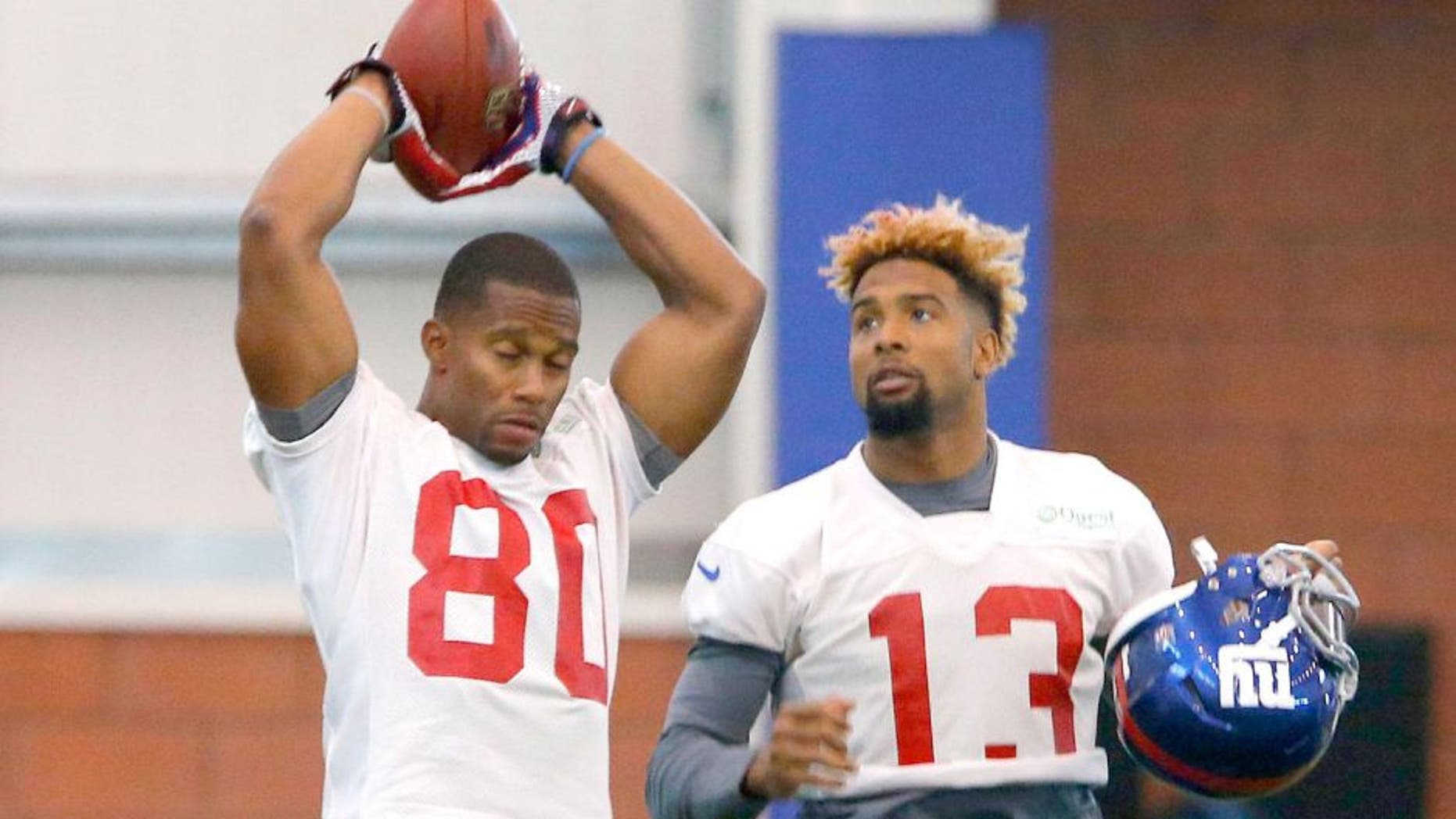 Jun 8, 2015; East Rutherford, NJ, USA; New York Giants wide receiver Victor Cruz (80) and New York Giants wide receiver Odell Beckham (13) during organized team activities at Quest Diagnostics Training Center. Mandatory Credit: Noah K. Murray-USA TODAY