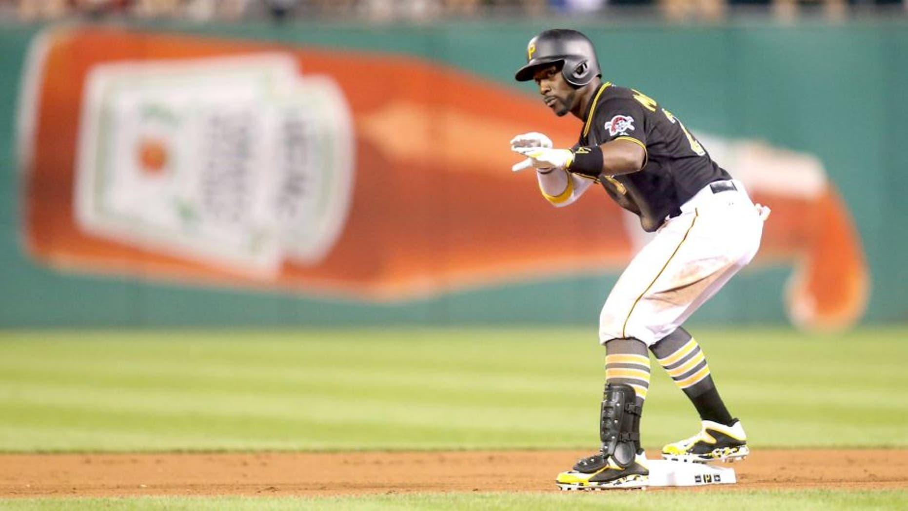 Jun 26, 2015; Pittsburgh, PA, USA; Pittsburgh Pirates center fielder Andrew McCutchen (22) reacts at second base after hitting a ground rule double against the Atlanta Braves during the tenth inning at PNC Park. The Pirates won 3-2 in ten innings. Mandatory Credit: Charles LeClaire-USA TODAY Sports