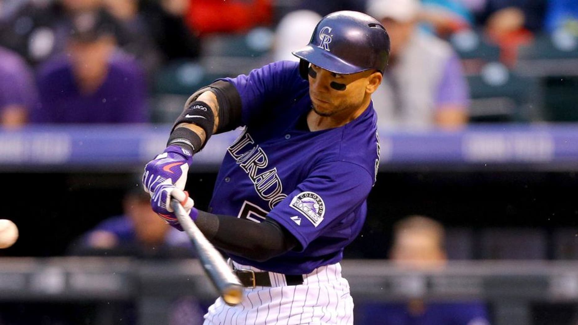DENVER, CO - AUGUST 18: Carlos Gonzalez #5 of the Colorado Rockies hits a two run home run off of Jordan Zimmermann of the Washington Nationals during the first inning at Coors Field on August 18, 2015 in Denver, Colorado. (Photo by Justin Edmonds/Getty Images)