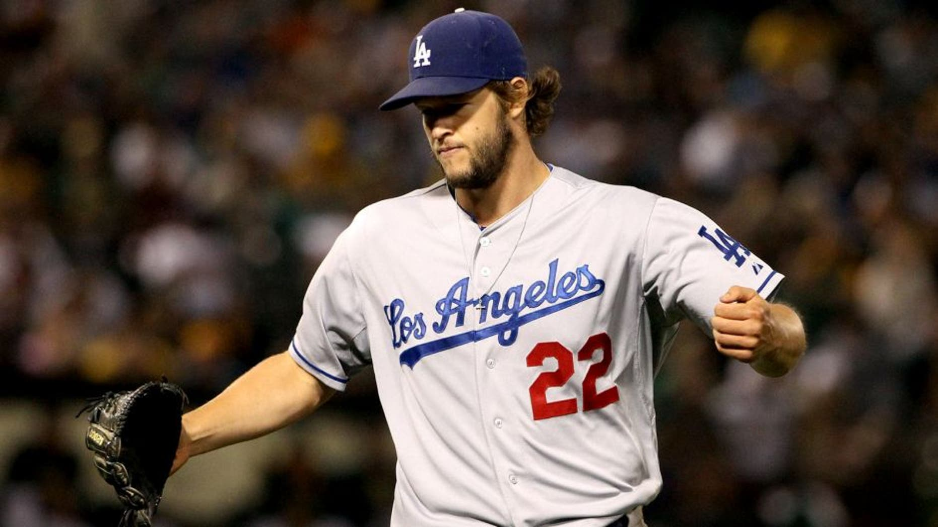 OAKLAND, CA - AUGUST 18: Clayton Kershaw #22 of the Los Angeles Dodgers reacts after the Dodgers got the last out of the seventh inning of their game against the Oakland Athletics at O.co Coliseum on August 18, 2015 in Oakland, California. (Photo by Ezra Shaw/Getty Images)