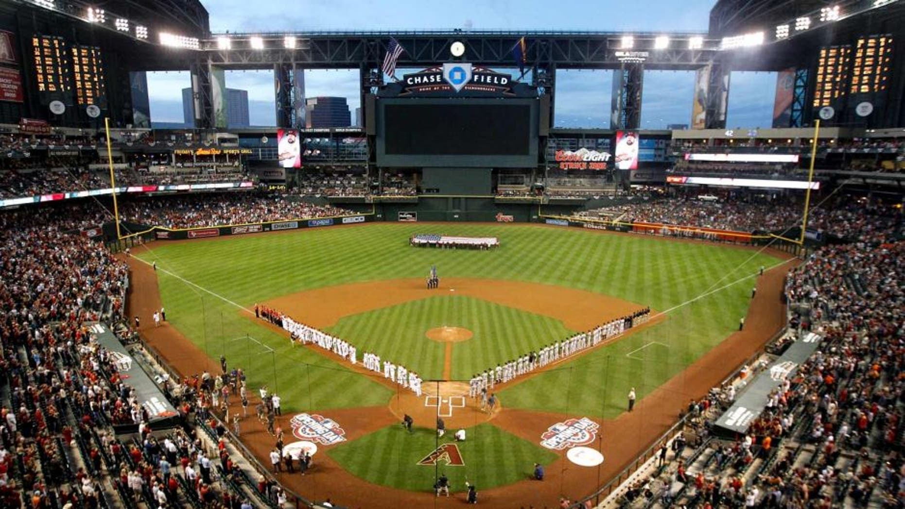 PHOENIX, AZ - APRIL 06: General view as the San Francisco Giants and the Arizona Diamondbacks stand attended for the national anthem before the Opening Day MLB game at Chase Field on April 6, 2015 in Phoenix, Arizona. (Photo by Christian Petersen/Getty Images)