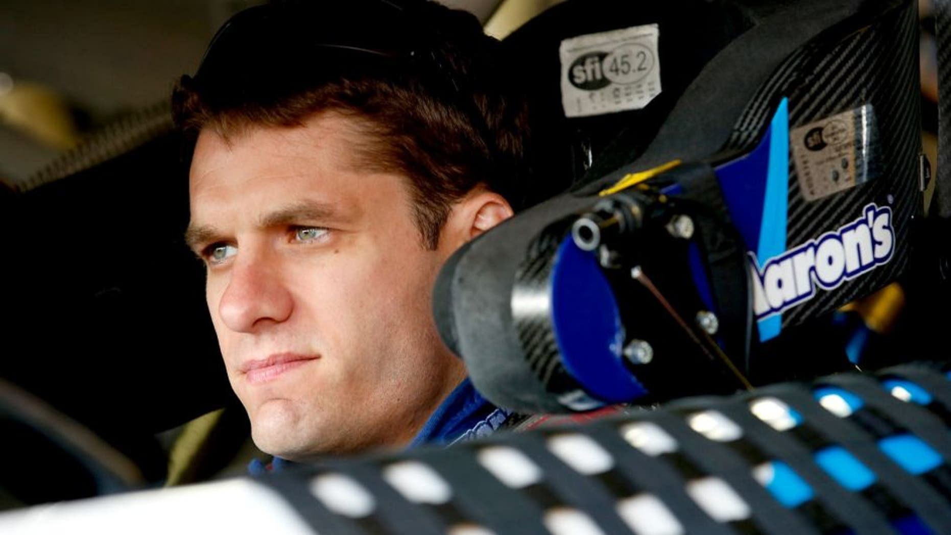 BROOKLYN, MI - AUGUST 15: David Ragan, driver of the #55 Aaron's Dream Machine Online Version Toyota, prepares to drive during practice for the NASCAR Sprint Cup Series Pure Michigan 400 at Michigan International Speedway on August 15, 2015 in Brooklyn, Michigan. (Photo by Gregory Shamus/Getty Images)