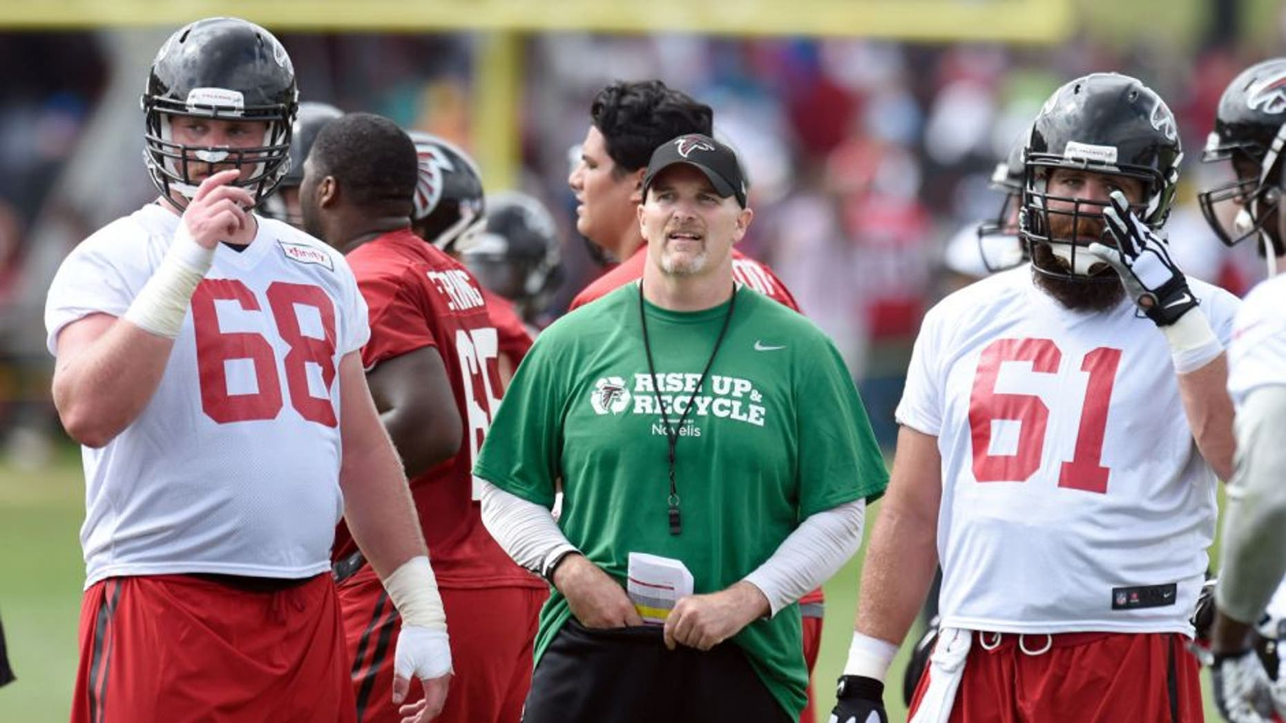 Aug 1, 2015; Atlanta, GA, USA; Atlanta Falcons head coach Dan Quinn shown on the field with players tackle Mike Person (68) and center Joe Hawley (61) during training camp at the Flowery Branch Training Facility. Mandatory Credit: Dale Zanine-USA TODAY Sports