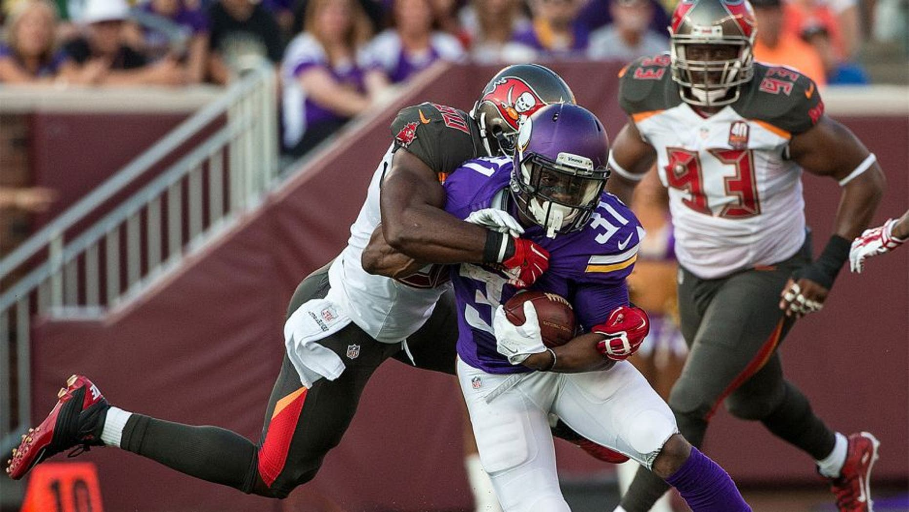 Aug 15, 2015; Minneapolis, MN, USA; Minnesota Vikings running back Jerick McKinnon (31) is tackled by Tampa Bay Buccaneers linebacker Bruce Carter (50) during the first quarter in a preseason NFL football game at TCF Bank Stadium. Mandatory Credit: Brace Hemmelgarn-USA TODAY Sports