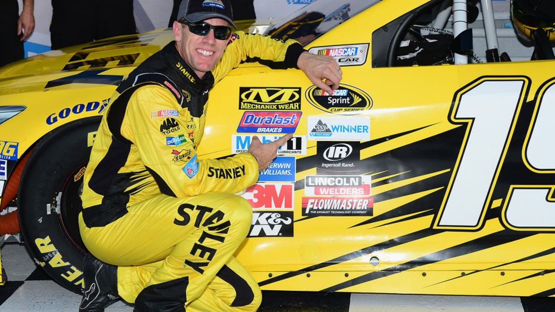 BRISTOL, TN - AUGUST 19: Carl Edwards, driver of the #19 Stanley Toyota, poses with the Coors Light Pole award after qualifying for the pole position for the NASCAR Sprint Cup Series Bass Pro Shops NRA Night Race at Bristol Motor Speedway on August 19, 2016 in Bristol, Tennessee. (Photo by Jeff Curry/NASCAR via Getty Images)