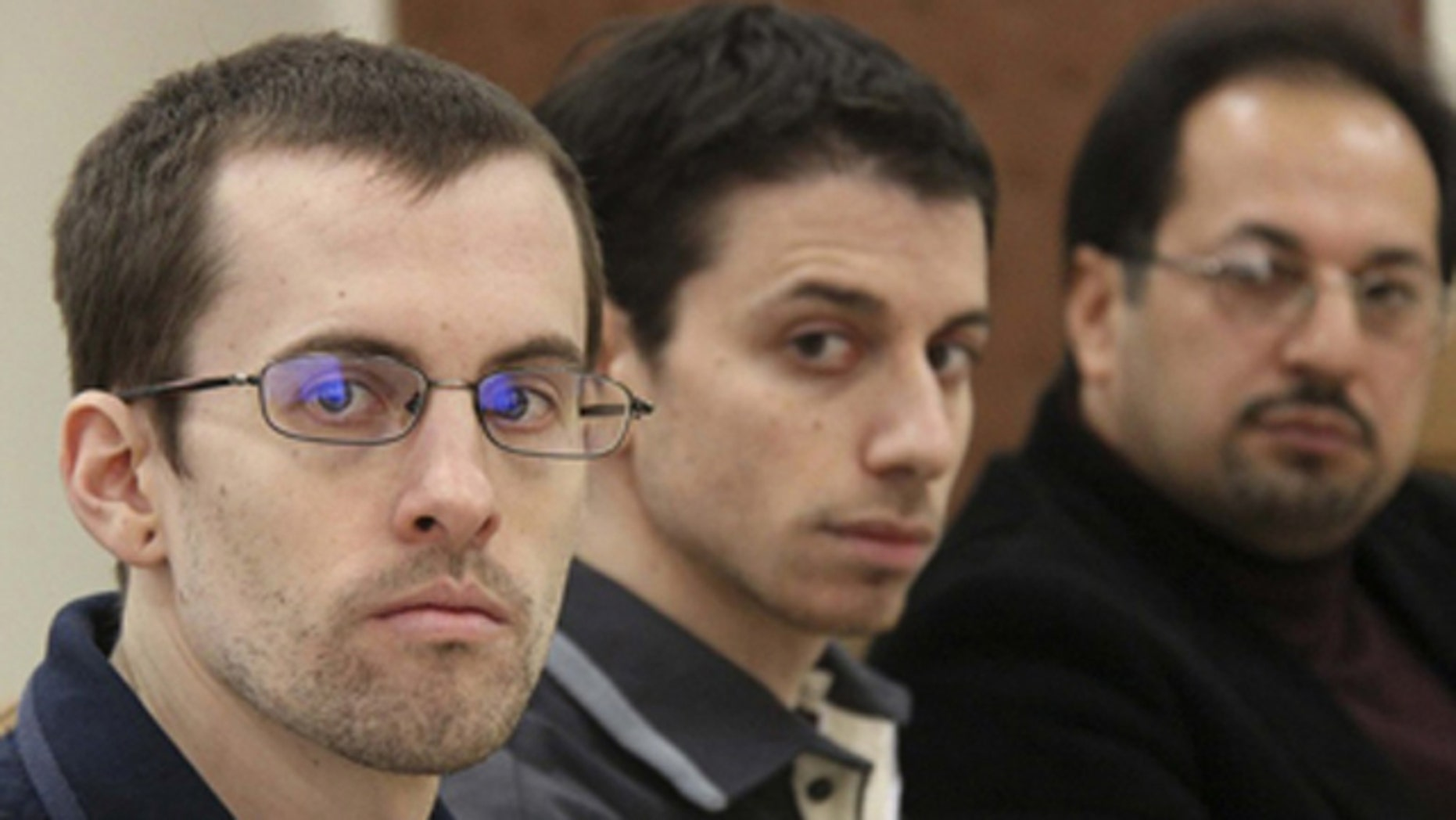 Feb. 6: American hikers Shane Bauer, left, and Josh Fattal, center, and their translator attend the first session of their trial at the revolutionary court in Tehran.