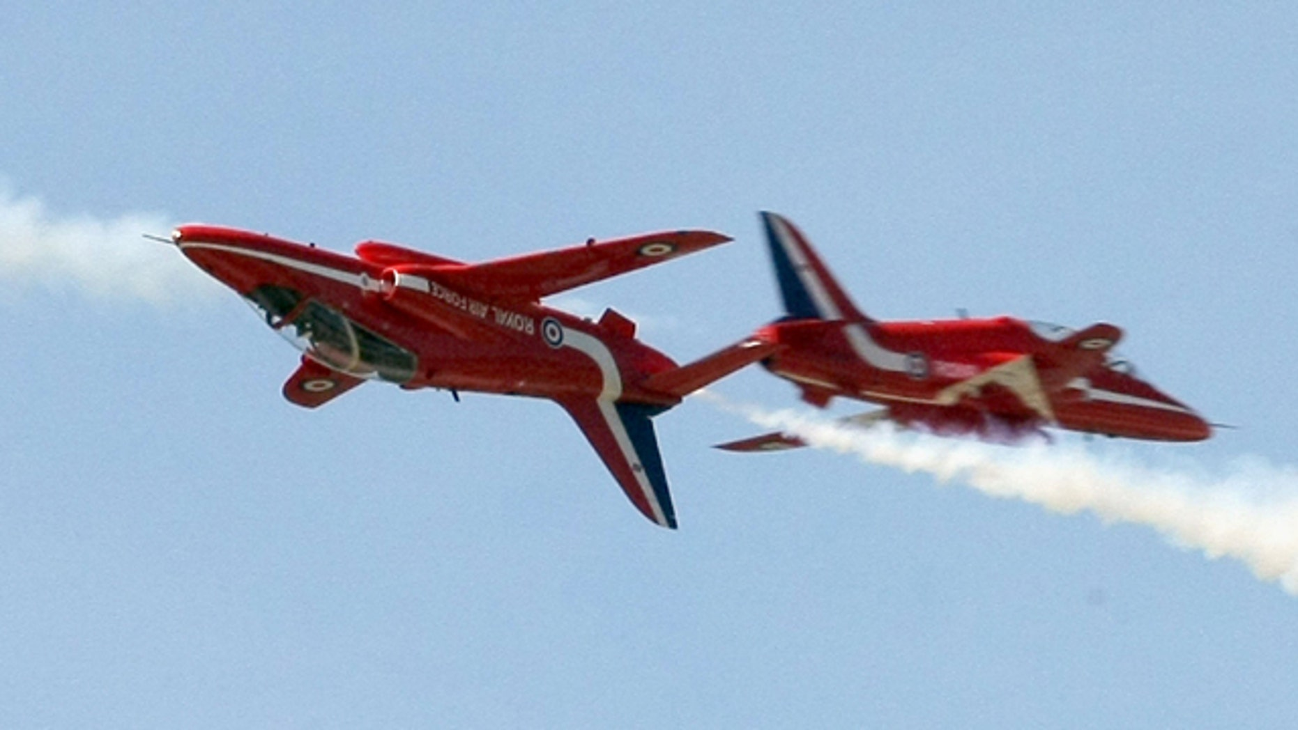 March 22, 2010: Britain's Red Arrows aerobatics squad fly over the Greek Air Force base of Kastelli, on the island of Crete, during a media presentation.