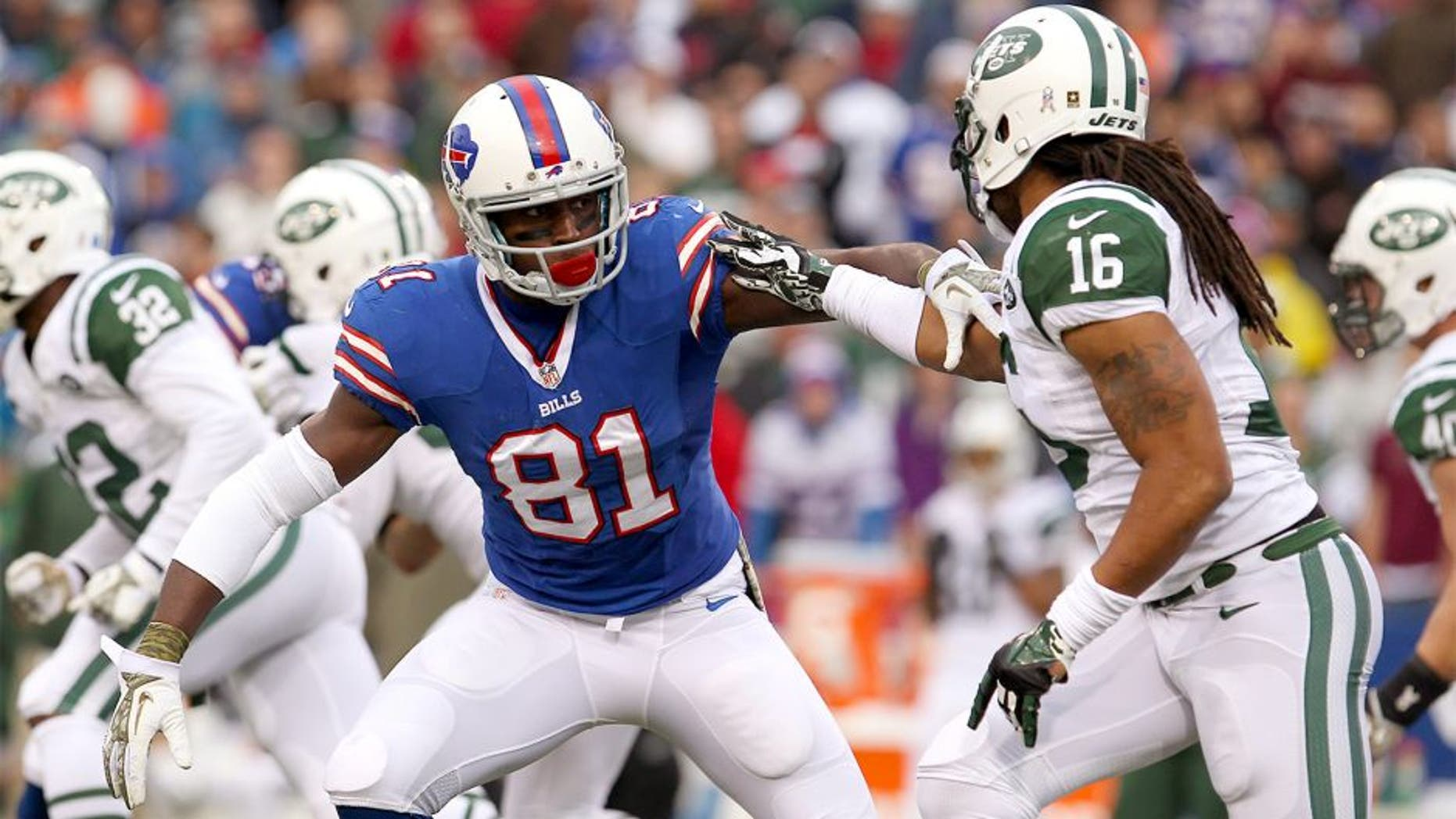 Nov 17, 2013; Orchard Park, NY, USA; Buffalo Bills wide receiver Marcus Easley (81) blocks New York Jets wide receiver Josh Cribbs (16) during the second half at Ralph Wilson Stadium. Bills beat the Jets 37 to 14. Mandatory Credit: Timothy T. Ludwig-USA TODAY Sports