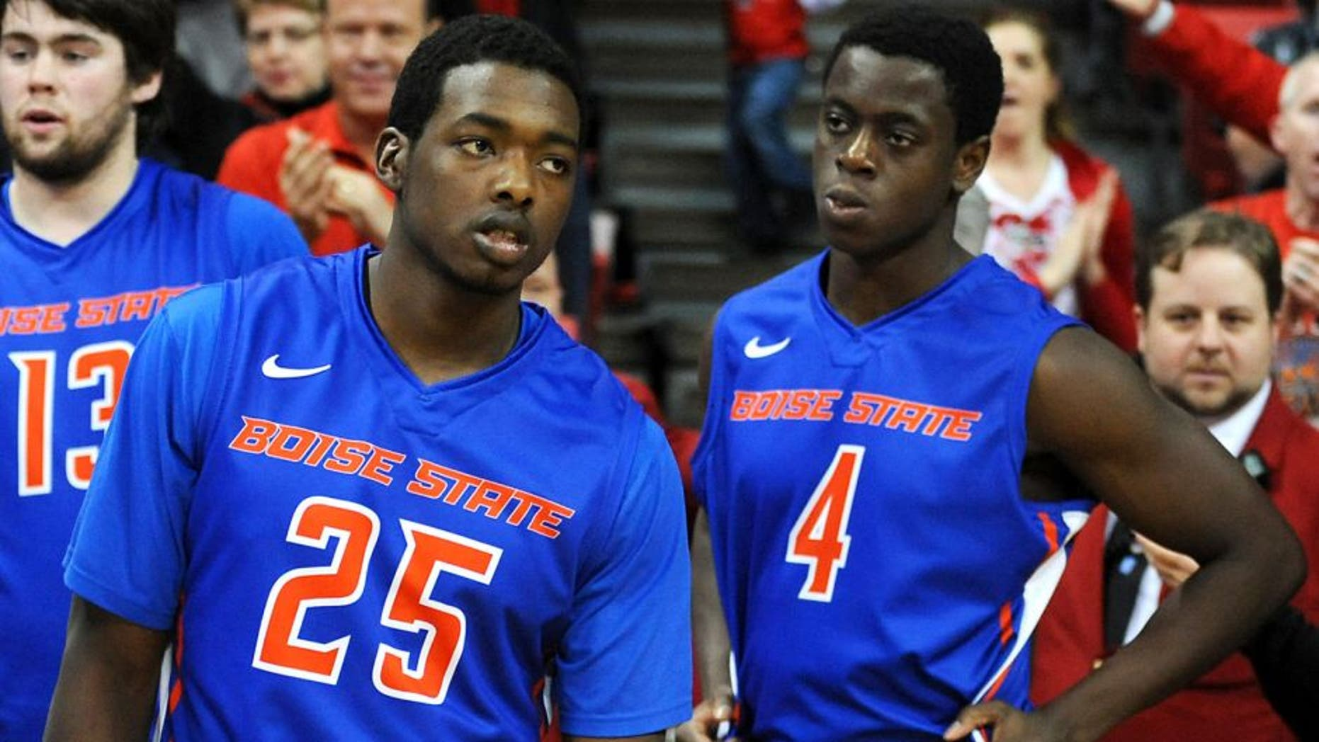 Feb 1, 2014; Las Vegas, NV, USA; Boise State Broncos players Dezmyn Trent (25) and Thomas Bropleh (4) react after the game against the UNLV Runnin' Rebels at Thomas & Mack Center. The Rebels won the game 73-69. Mandatory Credit: Stephen R. Sylvanie-USA TODAY Sports