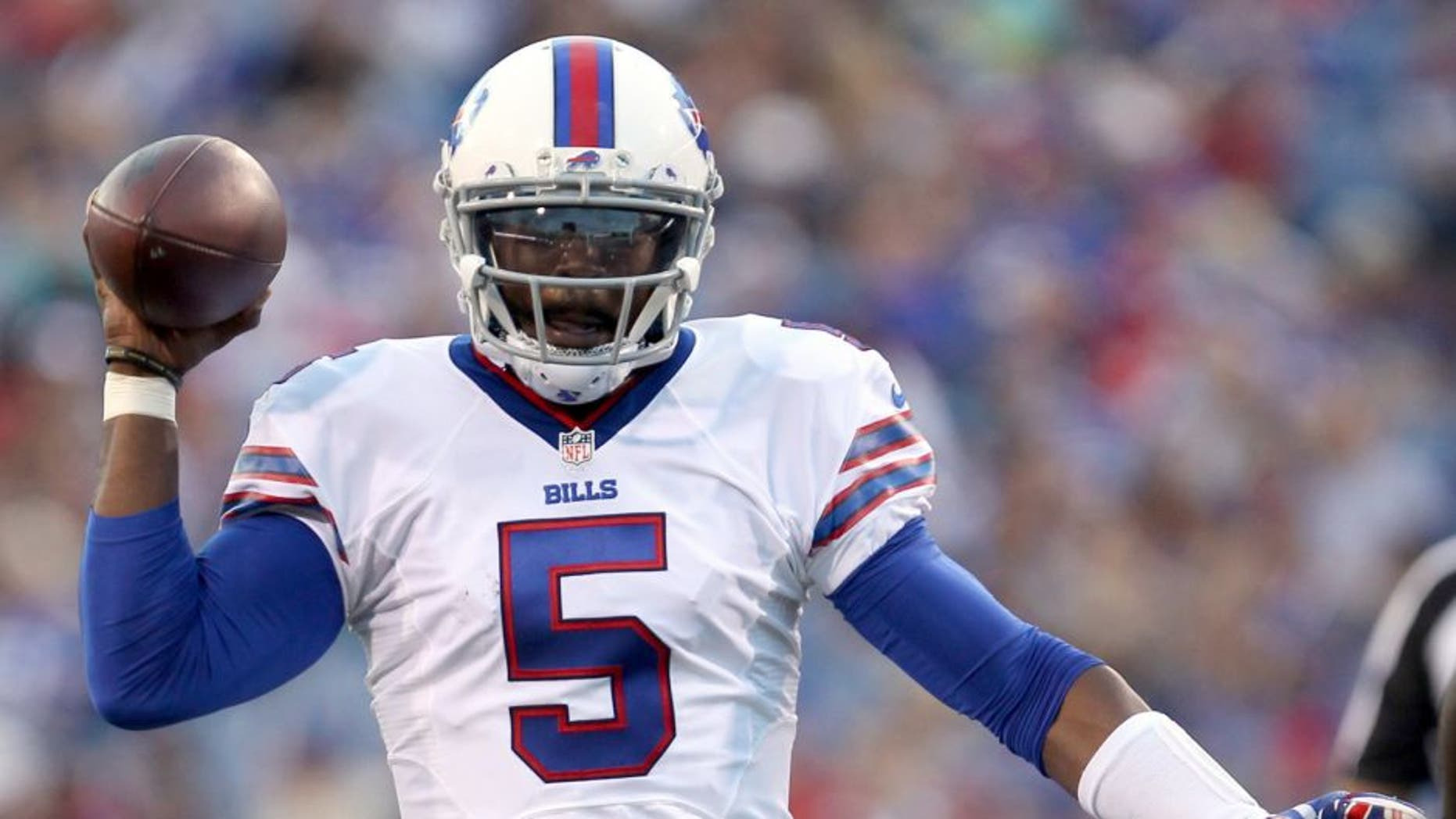 Aug 14, 2015; Orchard Park, NY, USA; Buffalo Bills quarterback Tyrod Taylor (5) throws a pass during the first half against the Carolina Panthers in a preseason NFL football game at Ralph Wilson Stadium. Mandatory Credit: Timothy T. Ludwig-USA TODAY Sports