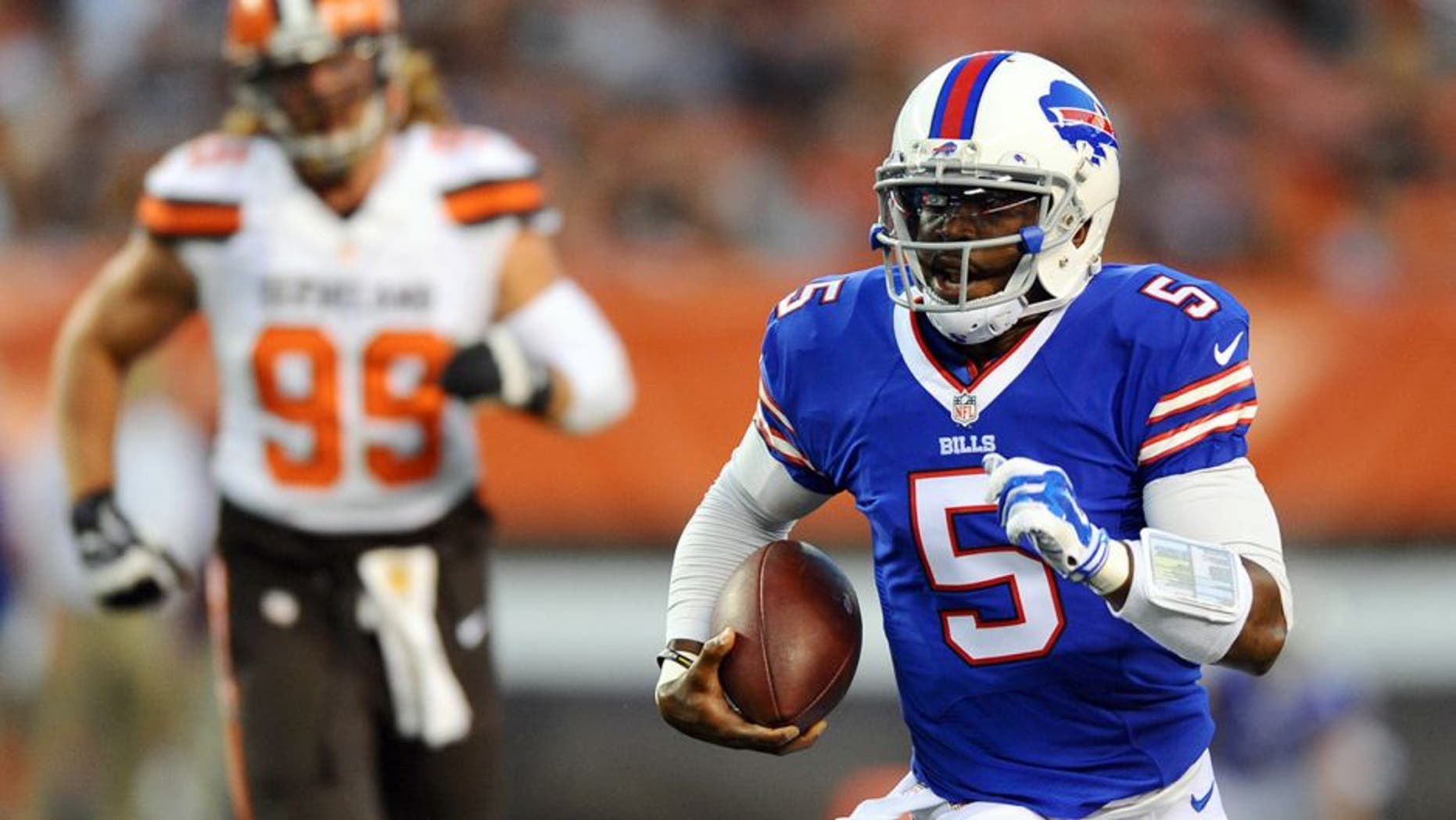 Aug 20, 2015; Cleveland, OH, USA; Buffalo Bills quarterback Tyrod Taylor (5) runs with the ball against the Cleveland Browns during the first quarter at FirstEnergy Stadium. Mandatory Credit: Ken Blaze-USA TODAY Sports
