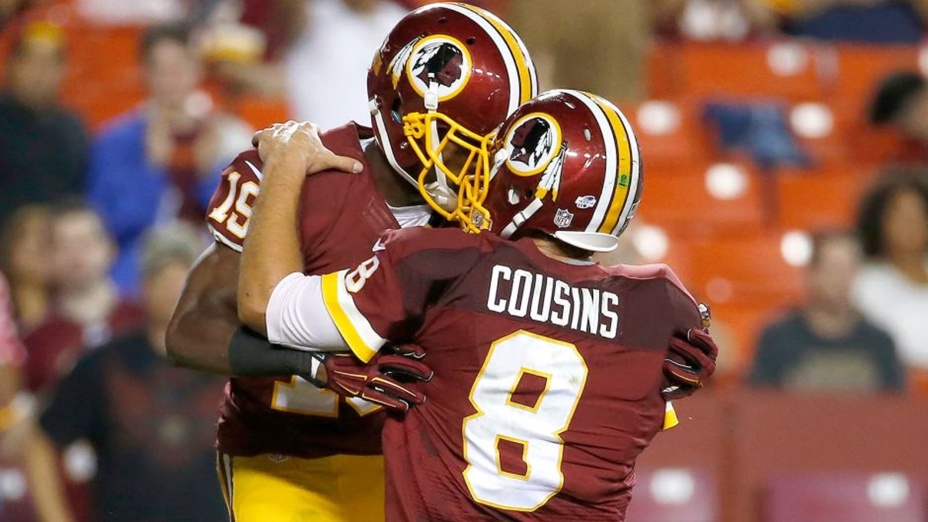 Washington Redskins wide receiver Rashad Ross (19) celebrates his touchdown with quarterback Kirk Cousins (8) during the second half of an NFL preseason football game against the Detroit Lions, Thursday, Aug. 20, 2015, in Landover, Md. (AP Photo/Alex Brandon)