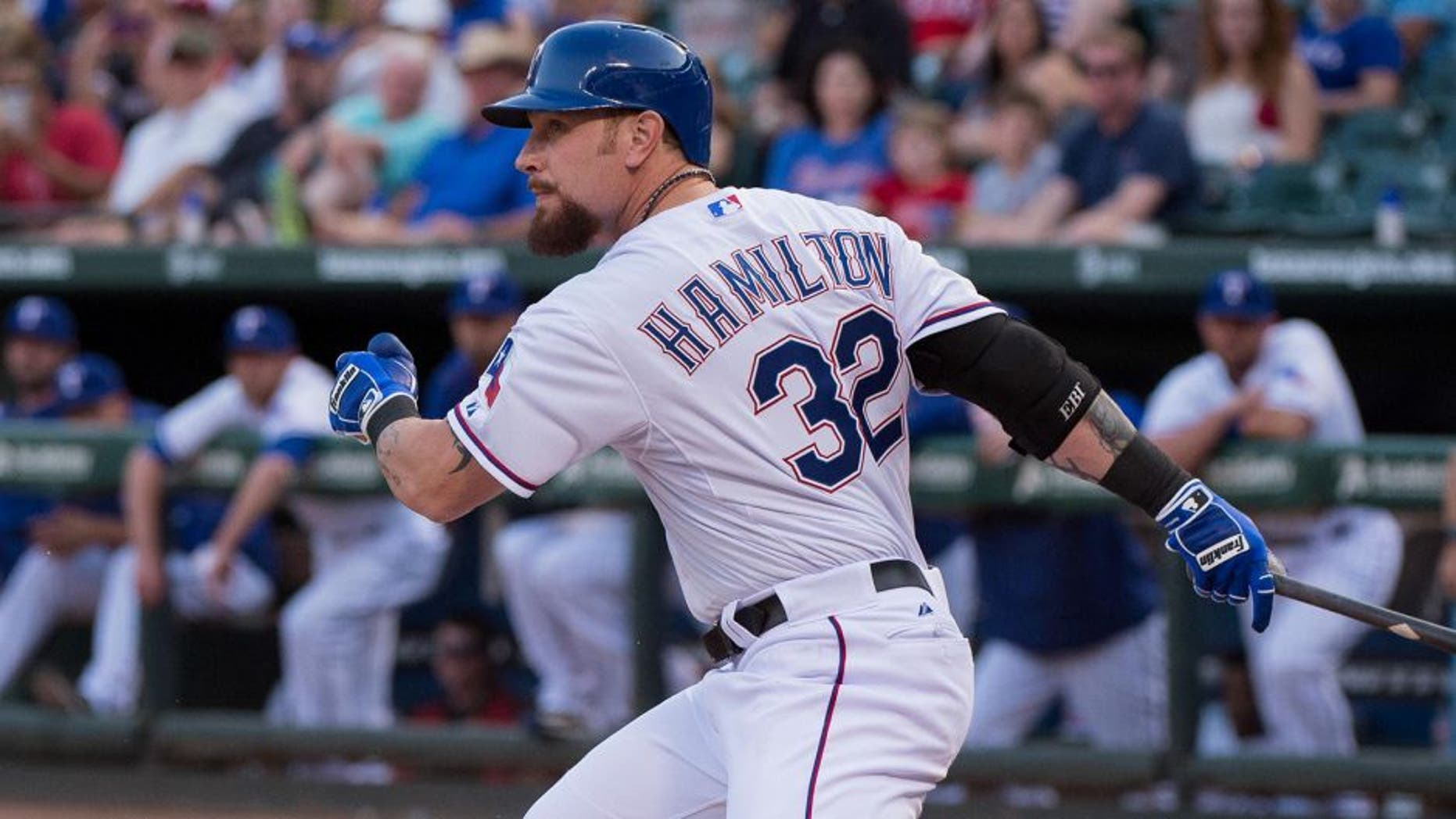 Aug 15, 2015; Arlington, TX, USA; Texas Rangers left fielder Josh Hamilton (32) bats against the Tampa Bay Rays during the game at Globe Life Park in Arlington. The Rangers defeated the Rays 12-4. Mandatory Credit: Jerome Miron-USA TODAY Sports