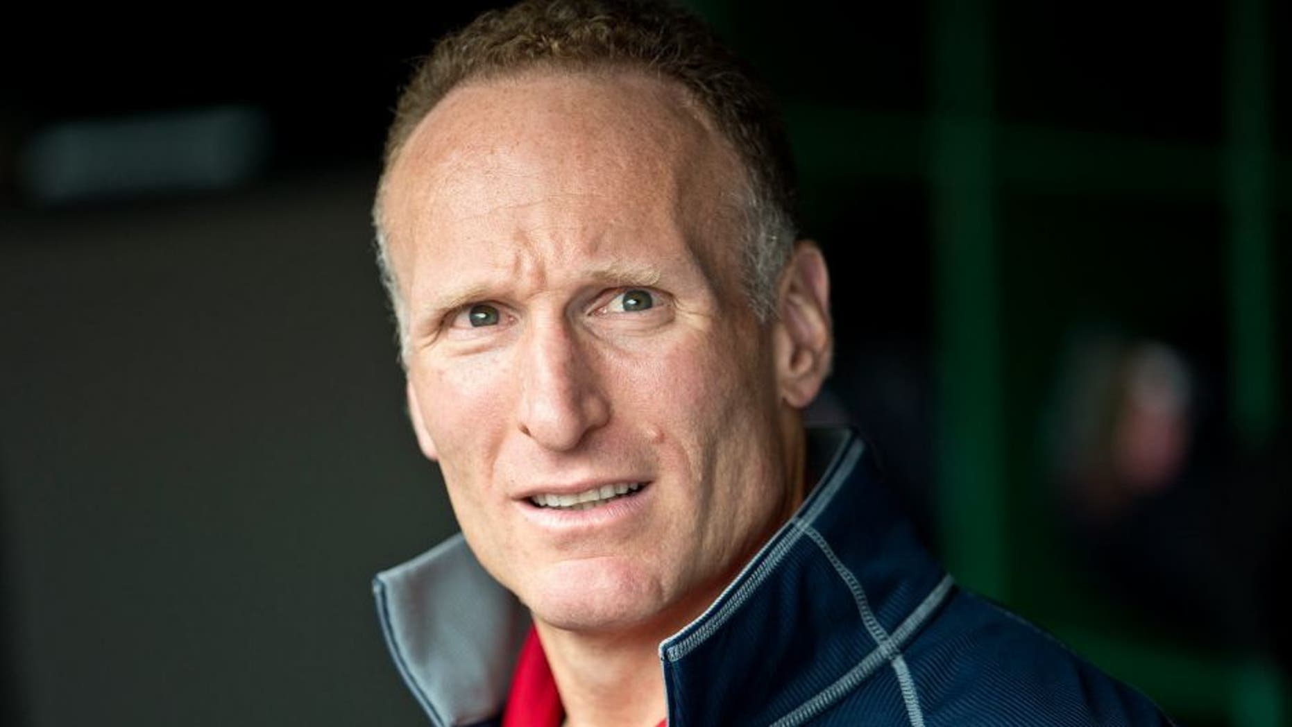 CLEVELAND, OH - JULY 10: President of the Cleveland Indians Mark Shapiro in the dugout prior to the game against the Toronto Blue Jays at Progressive Field on July 10, 2013 in Cleveland, Ohio. (Photo by Jason Miller/Getty Images)