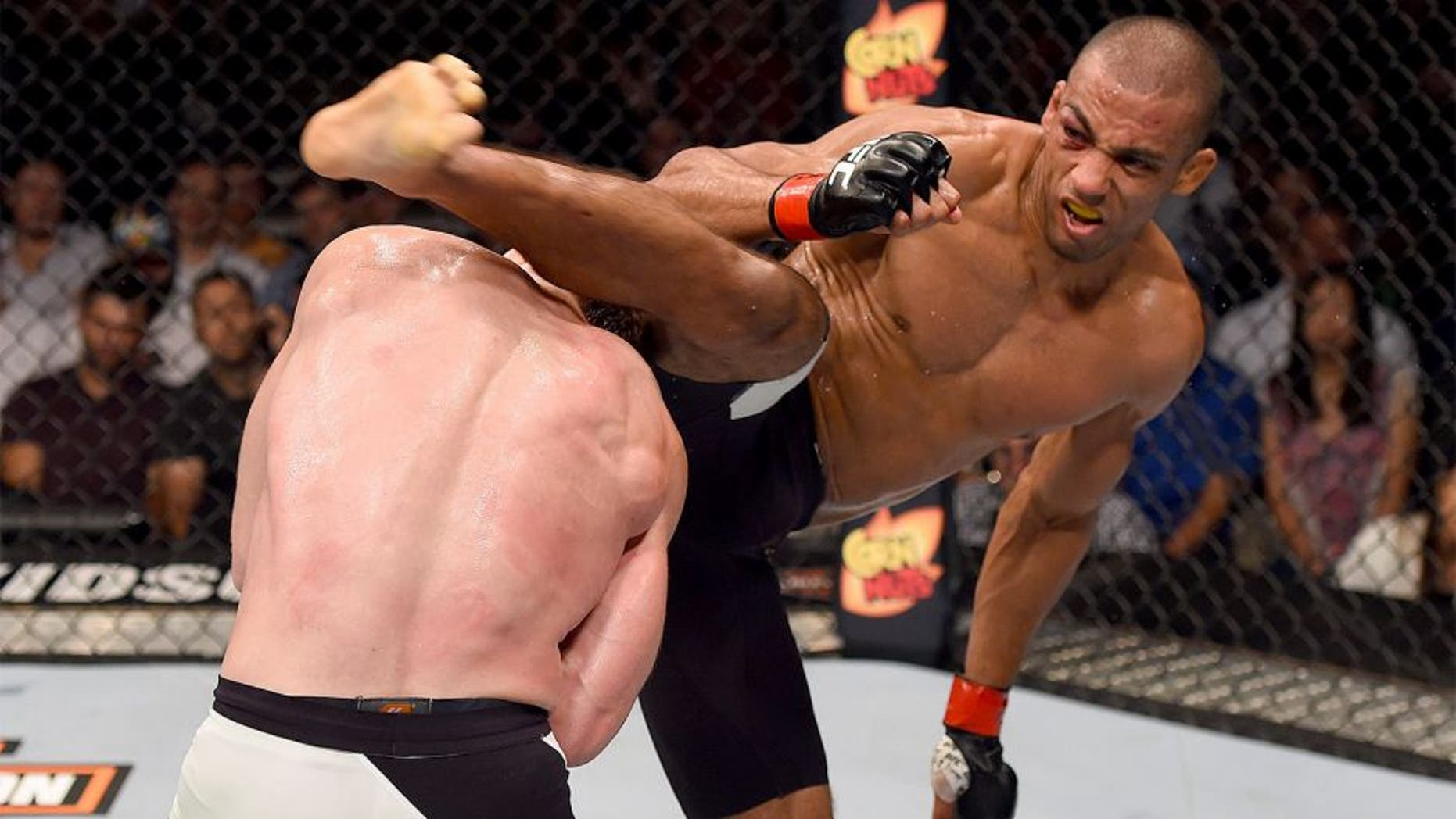 CHICAGO, IL - JULY 25: (R-L) Edson Barboza of Brazil kicks Paul Felder in their lightweight bout during the UFC event at the United Center on July 25, 2015 in Chicago, Illinois. (Photo by Jeff Bottari/Zuffa LLC/Zuffa LLC via Getty Images)