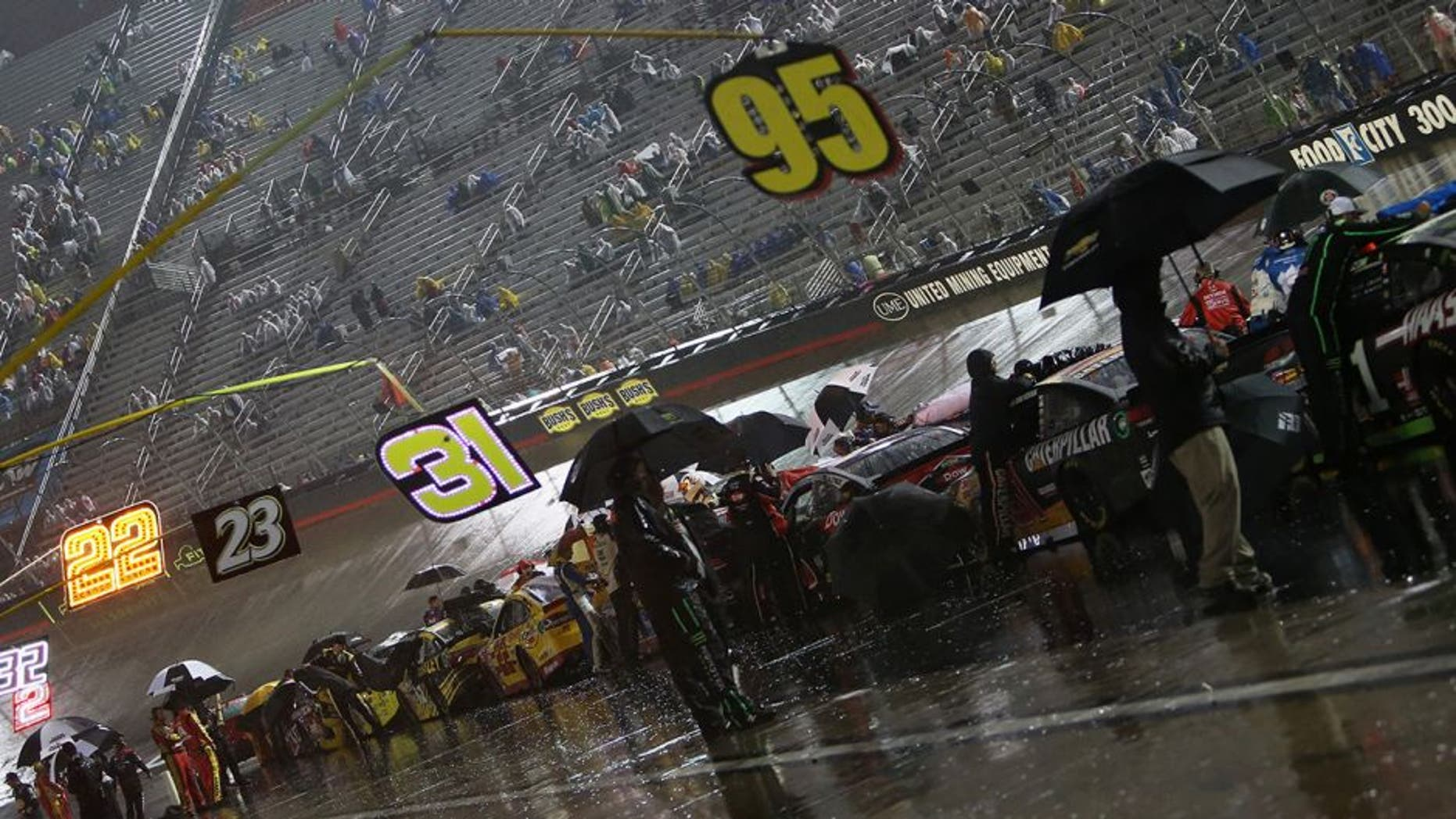 BRISTOL, TN - AUGUST 20: Cars line pit road during the second rain delay of the NASCAR Sprint Cup Series Bass Pro Shops NRA Night Race at Bristol Motor Speedway on August 20, 2016 in Bristol, Tennessee. (Photo by Rey Del Rio/Getty Images)
