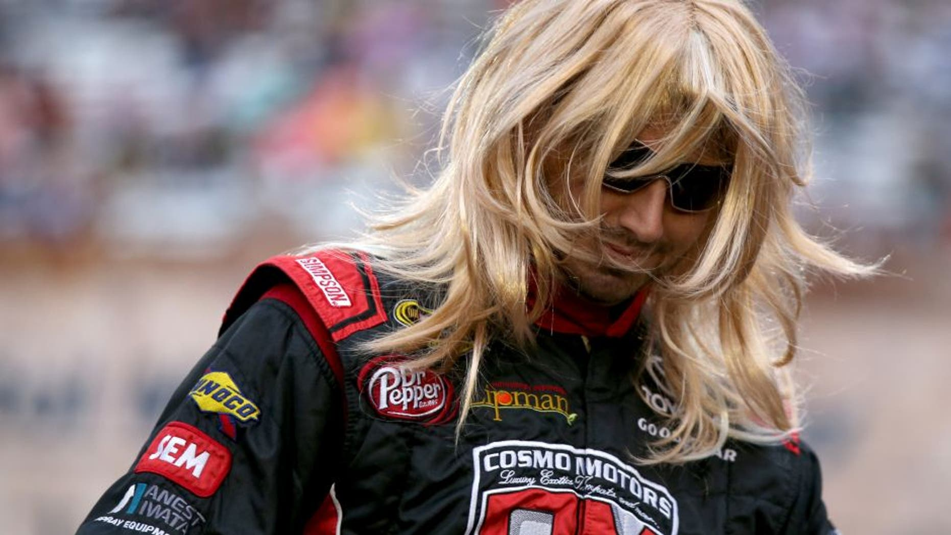 BRISTOL, TN - AUGUST 20: Matt DiBenedetto, driver of the #83 Cosmo Motors Toyota, is introduced in a wig prior to the NASCAR Sprint Cup Series Bass Pro Shops NRA Night Race at Bristol Motor Speedway on August 20, 2016 in Bristol, Tennessee. (Photo by Sean Gardner/Getty Images)