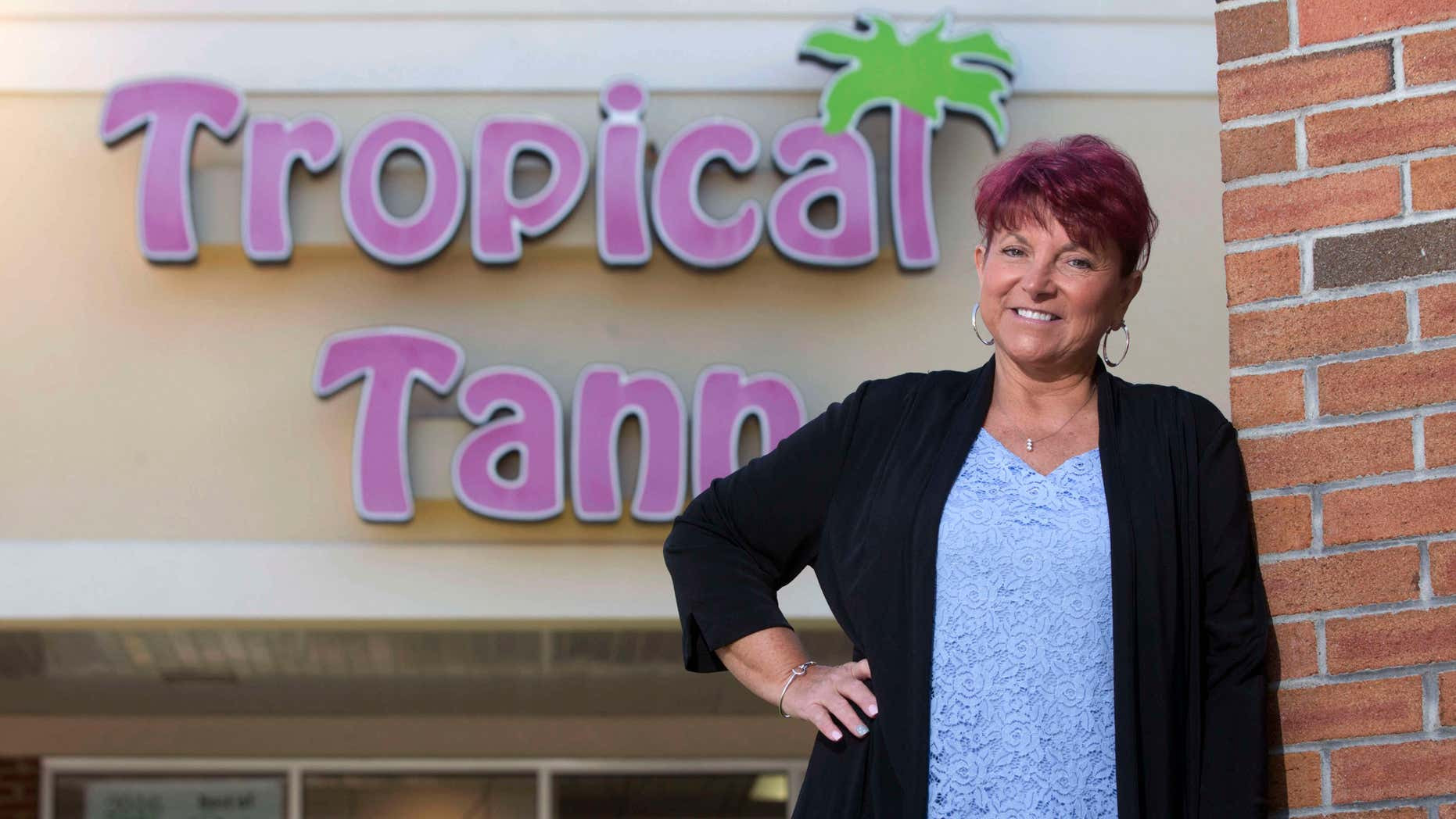 June 17, 2016: Kim Arnold stands for a photo outside her Tropical Tann business in Queensbury, N.Y.