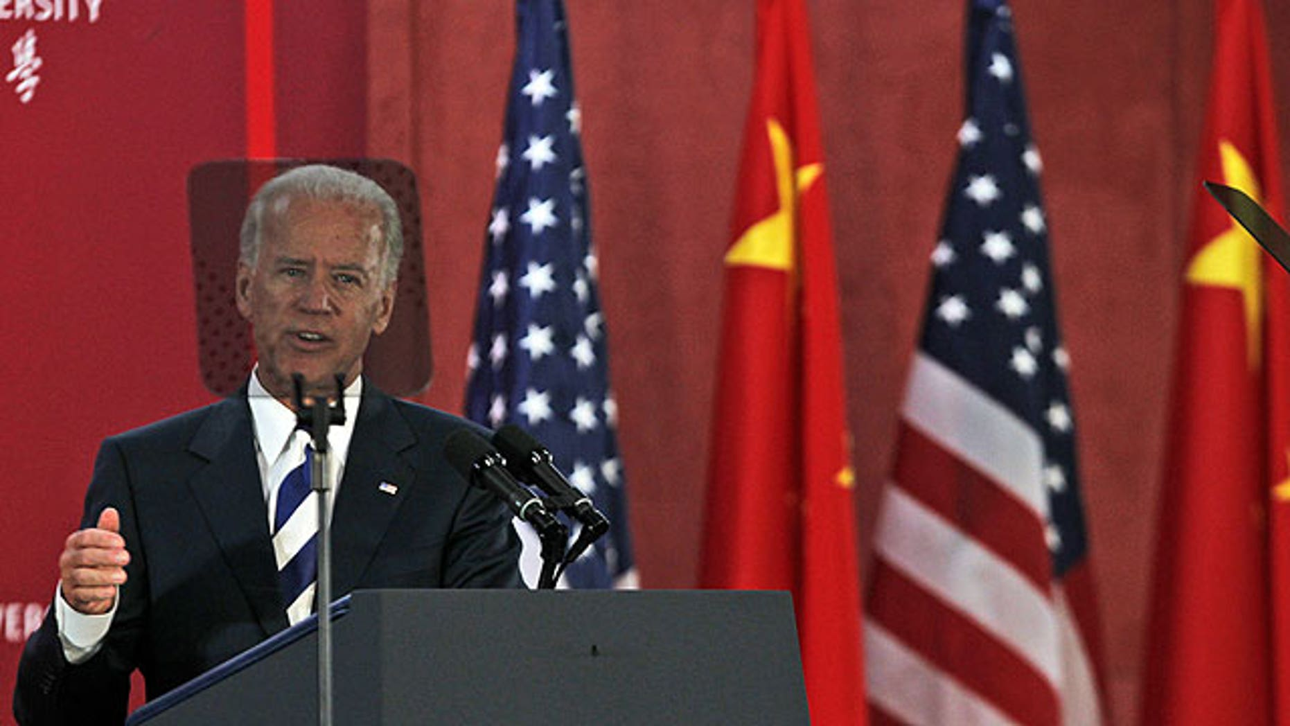 Aug 21: U.S. Vice President Joe Biden's head is framed by the teleprompter as he delivers a speech at Sichuan University in Chengdu in southwestern China's Sichuan province.
