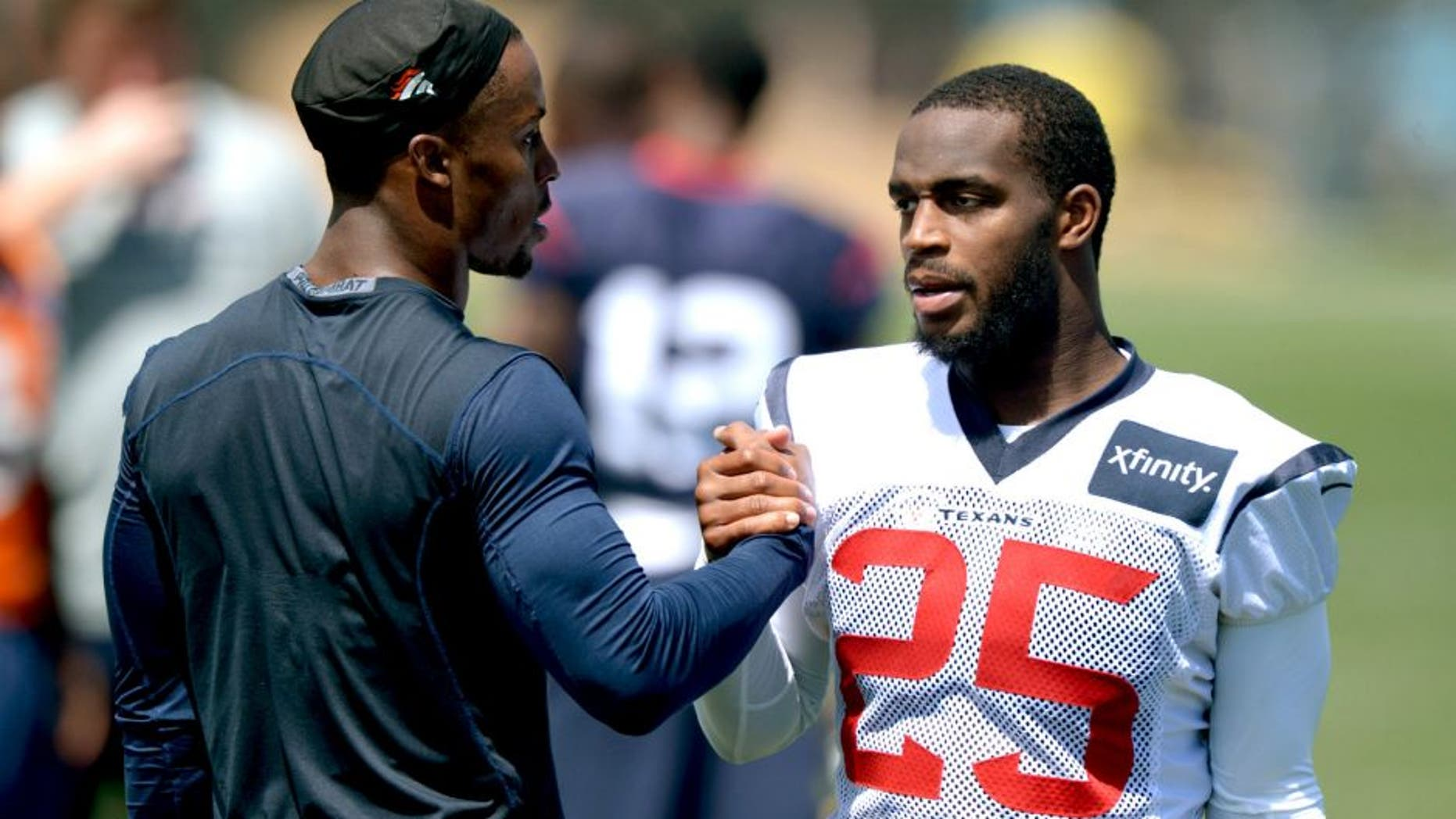 Aug 19, 2014; Englewood, CO, USA; Houston Texans cornerback Kareem Jackson (25) shakes hands with Denver Broncos safety Rahim Moore during scrimmage at the Broncos Headquarters. Mandatory Credit: Kirby Lee-USA TODAY Sports