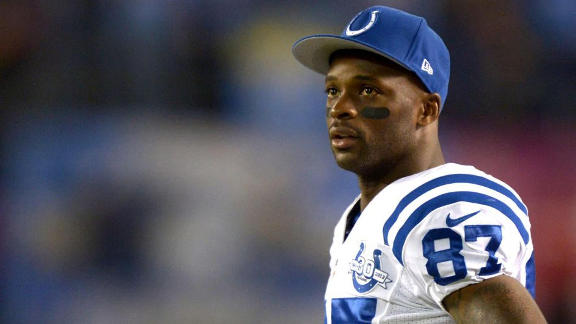 Oct 14, 2013; San Diego, CA, USA; Indianapolis Colts receiver Reggie Wayne (87) watches on the sidelines during the game against the San Diego Chargers at Qualcomm Stadium. The Chargers defeated the Colts 19-9. Mandatory Credit: Kirby Lee-USA TODAY Sports