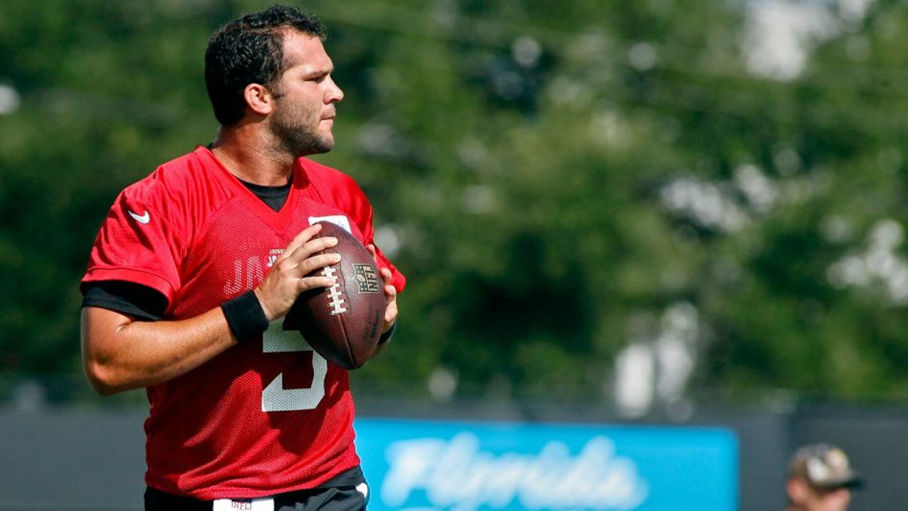 Jul 25, 2014; Jacksonville, FL, USA; Jacksonville Jaguars quarterback Blake Bortles (5) goes back to pass during the first day of training camp at Florida Blue Health and Wellness Practice Fields. Mandatory Credit: Phil Sears-USA TODAY Sports