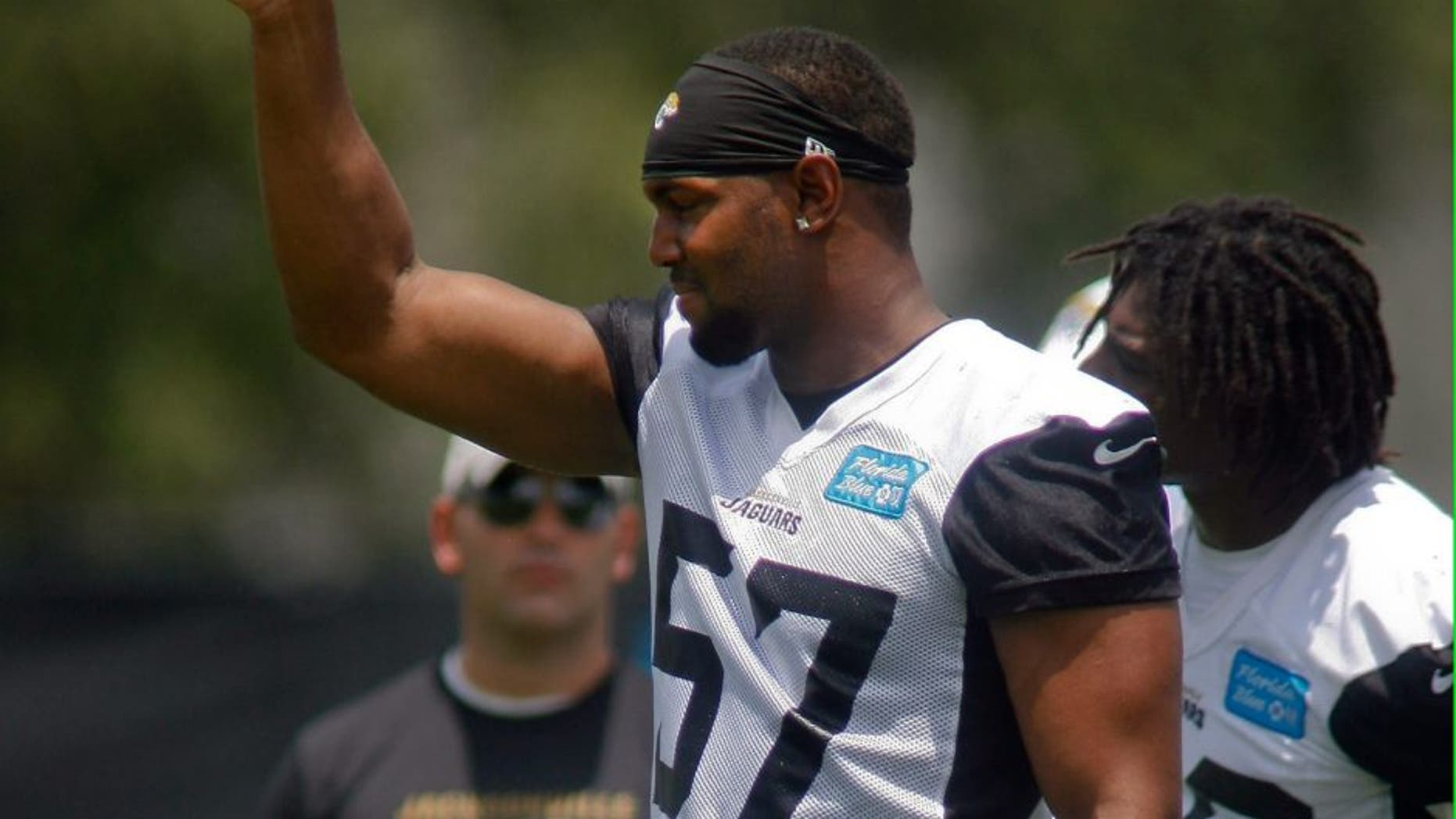 Jun 17, 2014; Jacksonville, FL, USA; Jacksonville Jaguars linebacker Dekoda Watson (57) reacts after a defensive play during the first day of minicamp at Florida Blue Health and Wellness Practice Fields. Mandatory Credit: Phil Sears-USA TODAY Sports