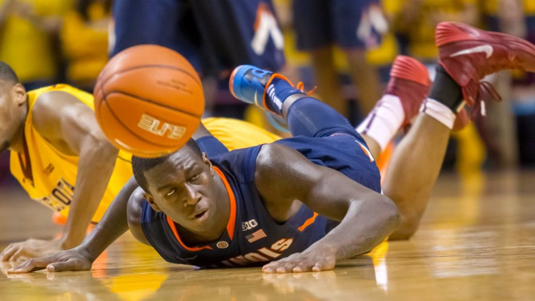 Feb 19, 2014; Minneapolis, MN, USA; Illinois Fighting Illini forward Darius Paul (35) dives for a loose ball in the first half against the Minnesota Gophers at Williams Arena. Mandatory Credit: Brad Rempel-USA TODAY Sports
