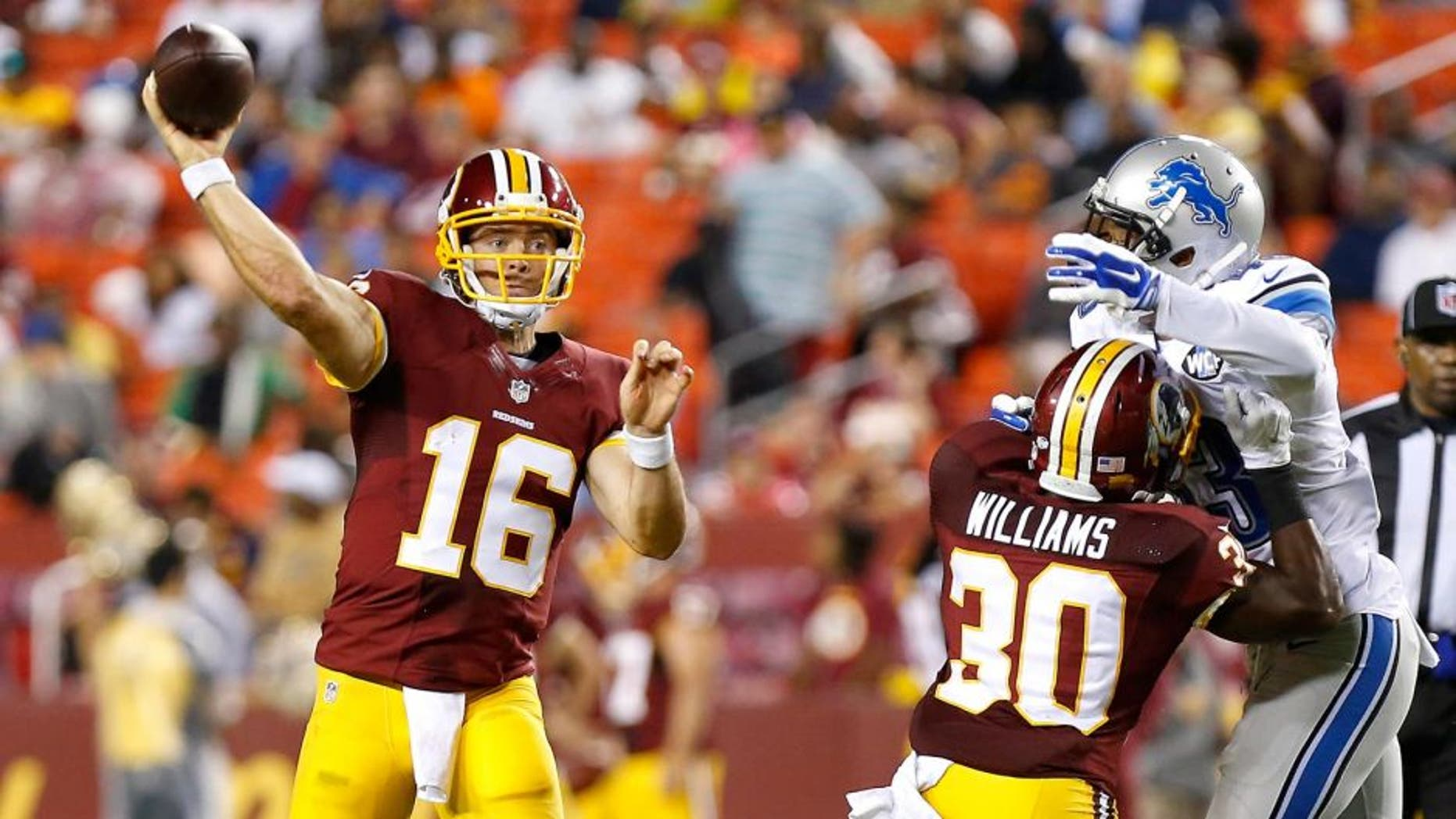 Aug 20, 2015; Landover, MD, USA; Washington Redskins quarterback Colt McCoy (16) throws the ball as Detroit Lions defensive back Isaiah Johnson (43) chases in the third quarter at FedEx Field. The Redskins won 21-17. Mandatory Credit: Geoff Burke-USA TODAY Sports