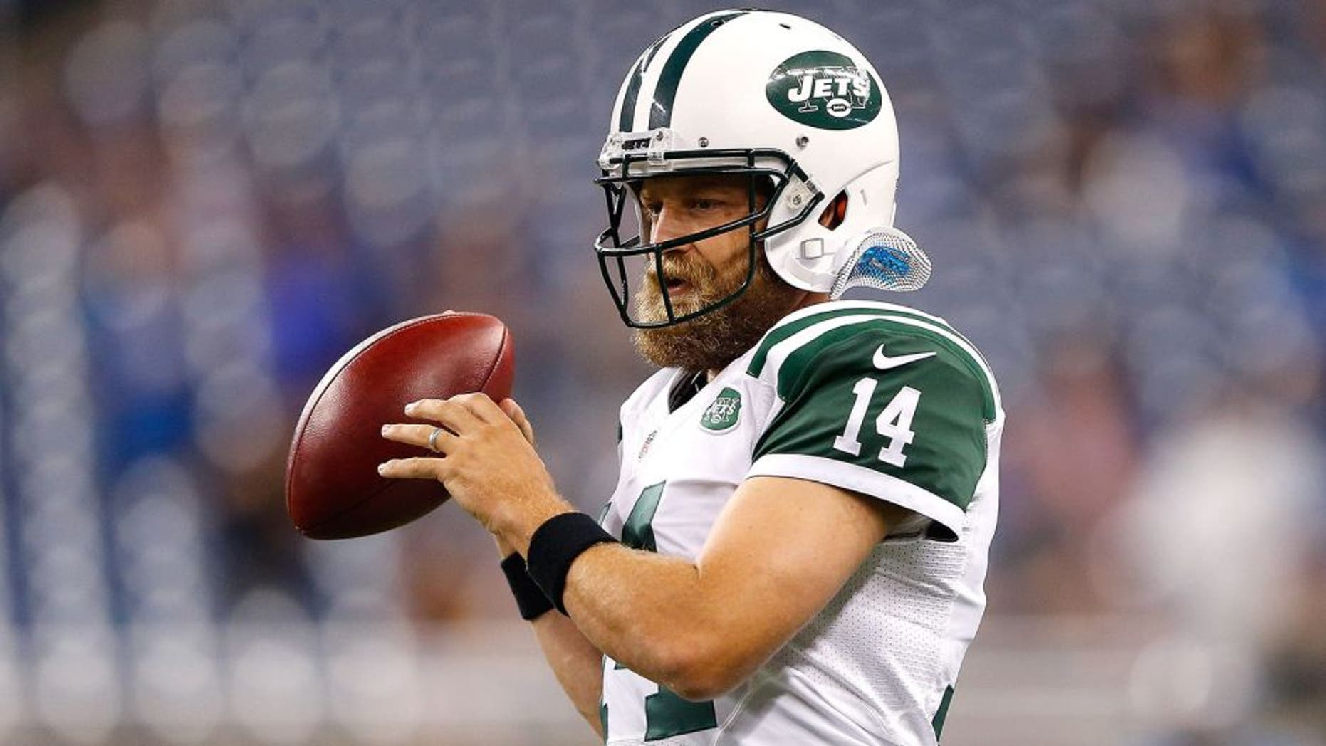 DETROIT, MI - AUGUST 13: Ryan Fitzpatrick #14 of the New York Jets warms up prior to the start of the preseason game against the Detroit Lions on August 13, 2015 at Ford Field Detroit, Michigan. The Lions defeated the Jets 23-3. (Photo by Leon Halip/Getty Images)